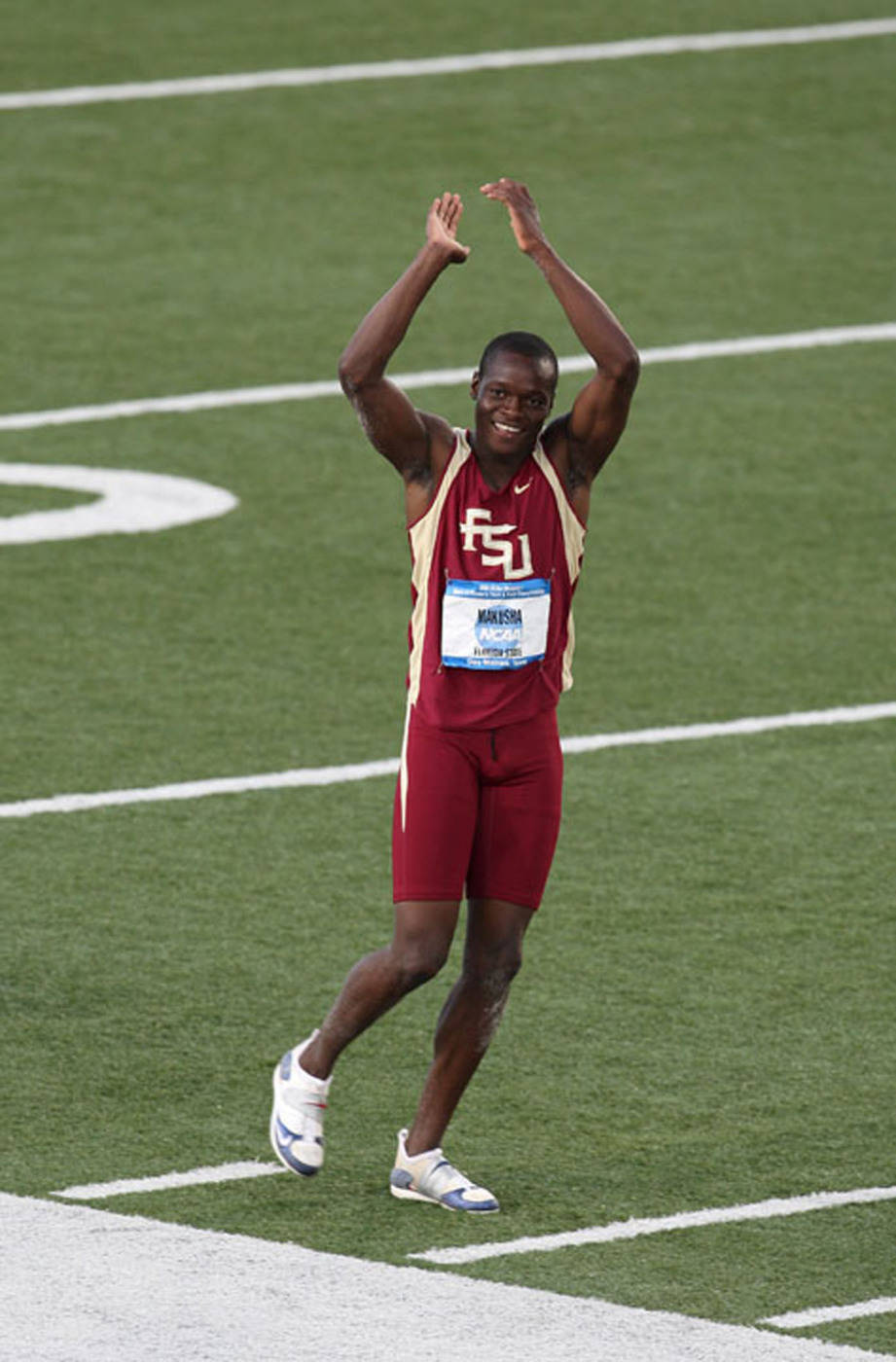 Ngoni Makusha returns the applause of the crowd after winning the long jump.