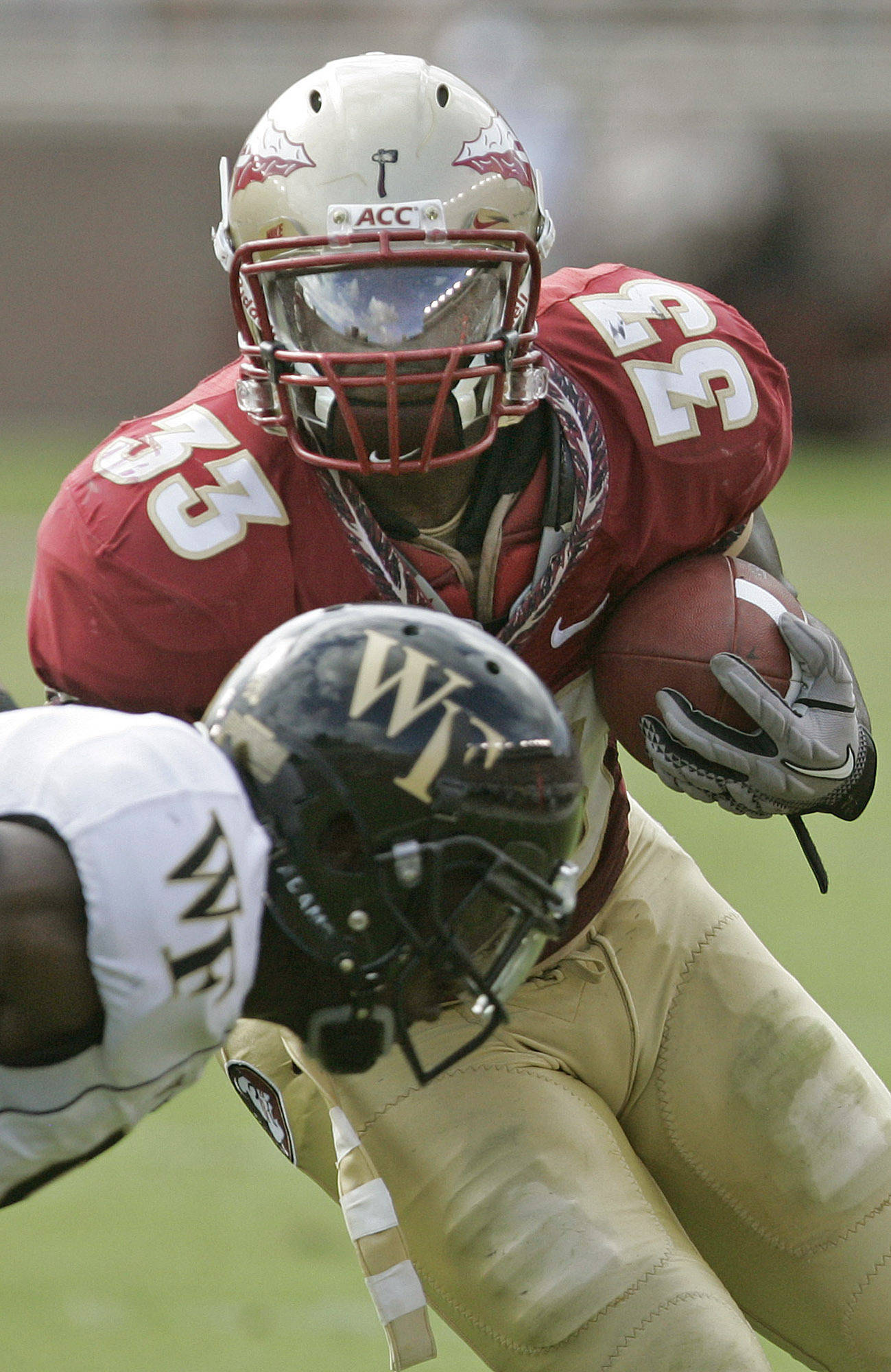 Florida State's Ty Jones (33) looks upfield after dodging a Wake Forest defender in the second quarter of an NCAA college football game on Saturday, Sept. 25, 2010, in Tallahassee, Fla. (AP Photo/Steve Cannon)