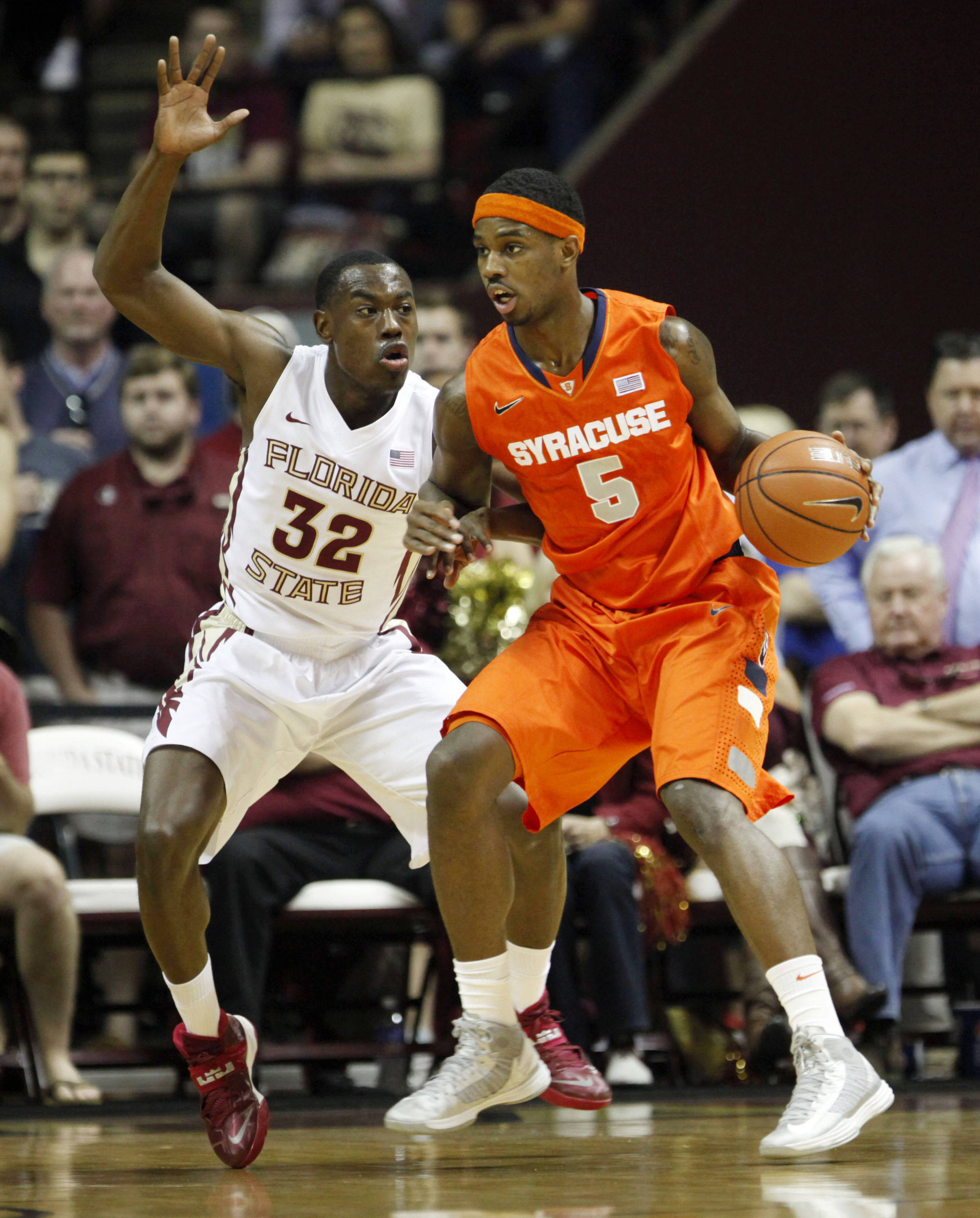 Mar 9, 2014; Tallahassee, FL, USA; Florida State Seminoles guard Montay Brandon (32) guards Syracuse Orange forward C.J. Fair (5) during the first half at Donald L. Tucker Center. Mandatory Credit: Matt Stamey-USA TODAY Sports