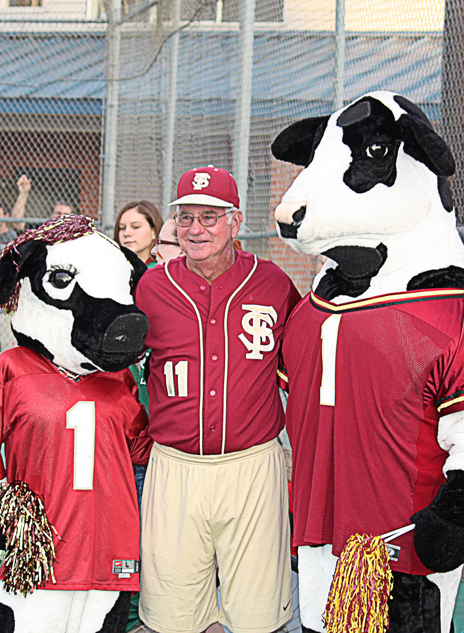 Mike Martin (11) stands with Chick-Fil-A's mascots