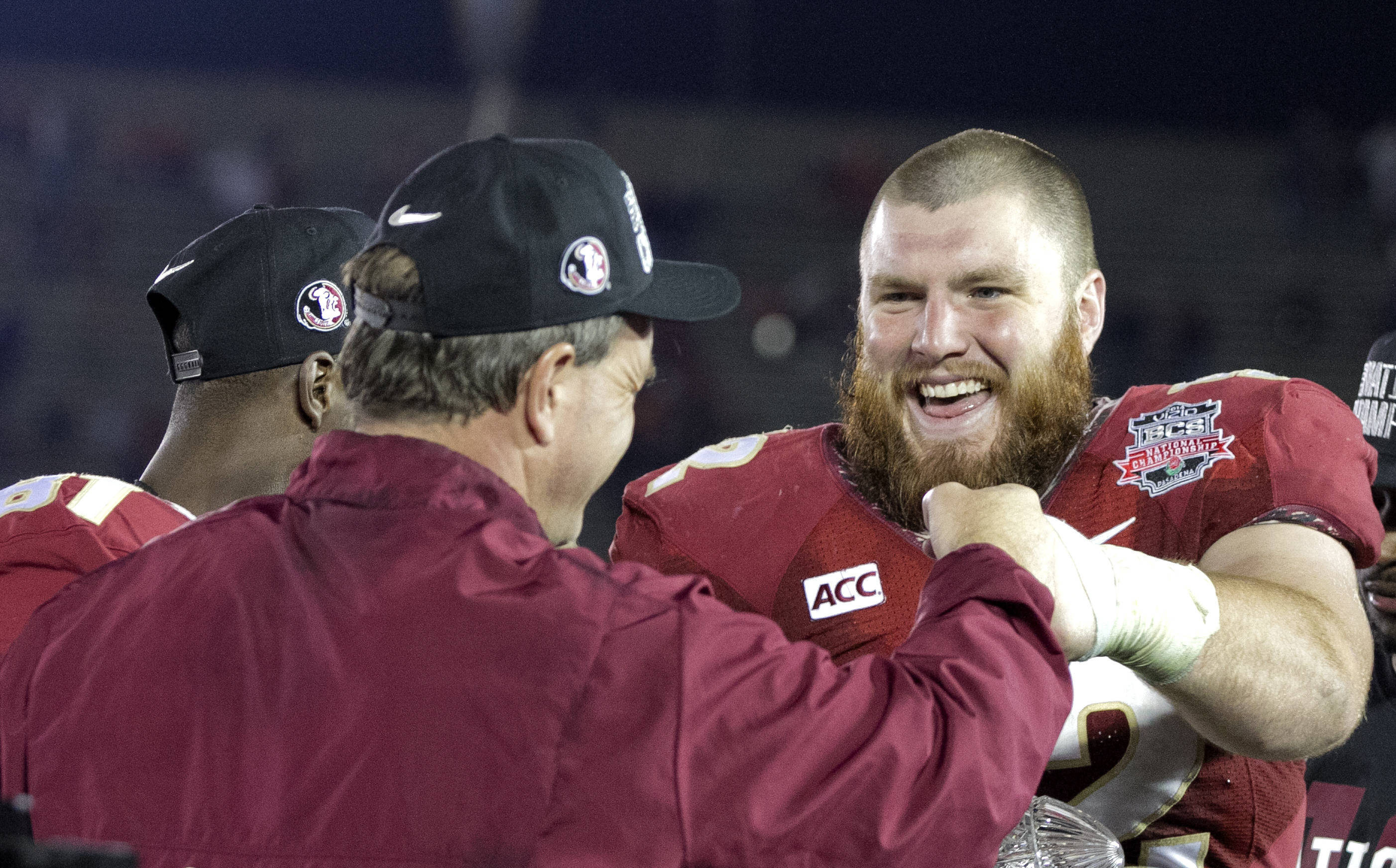 Coach Fisher and All-American Center Brian Stork share a fist pump, BCS Championship, FSU vs Auburn, Rose Bowl, Pasadena, CA,  1-06-14,  (Photo by Steve Musco)