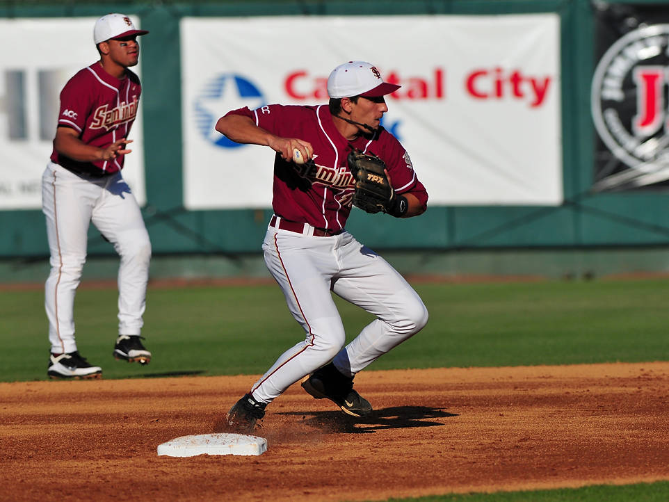 Shortstop Justin Gonzalez steps on the bag and relays a throw to first base in the early going Tuesday night.