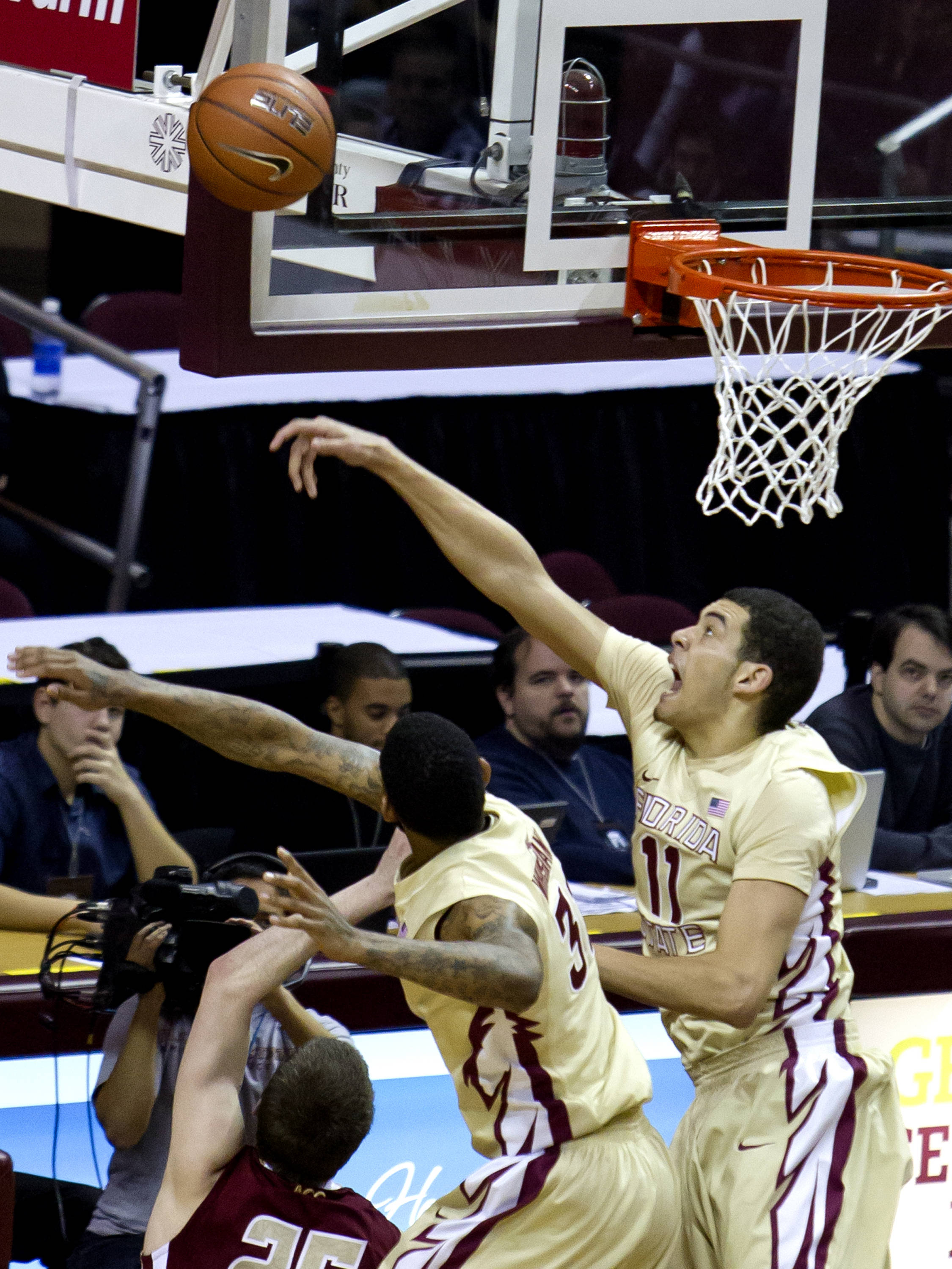 Kiel Turpin (11) with a block, FSU vs BC, 02/16/13. (Photo by Steve Musco)