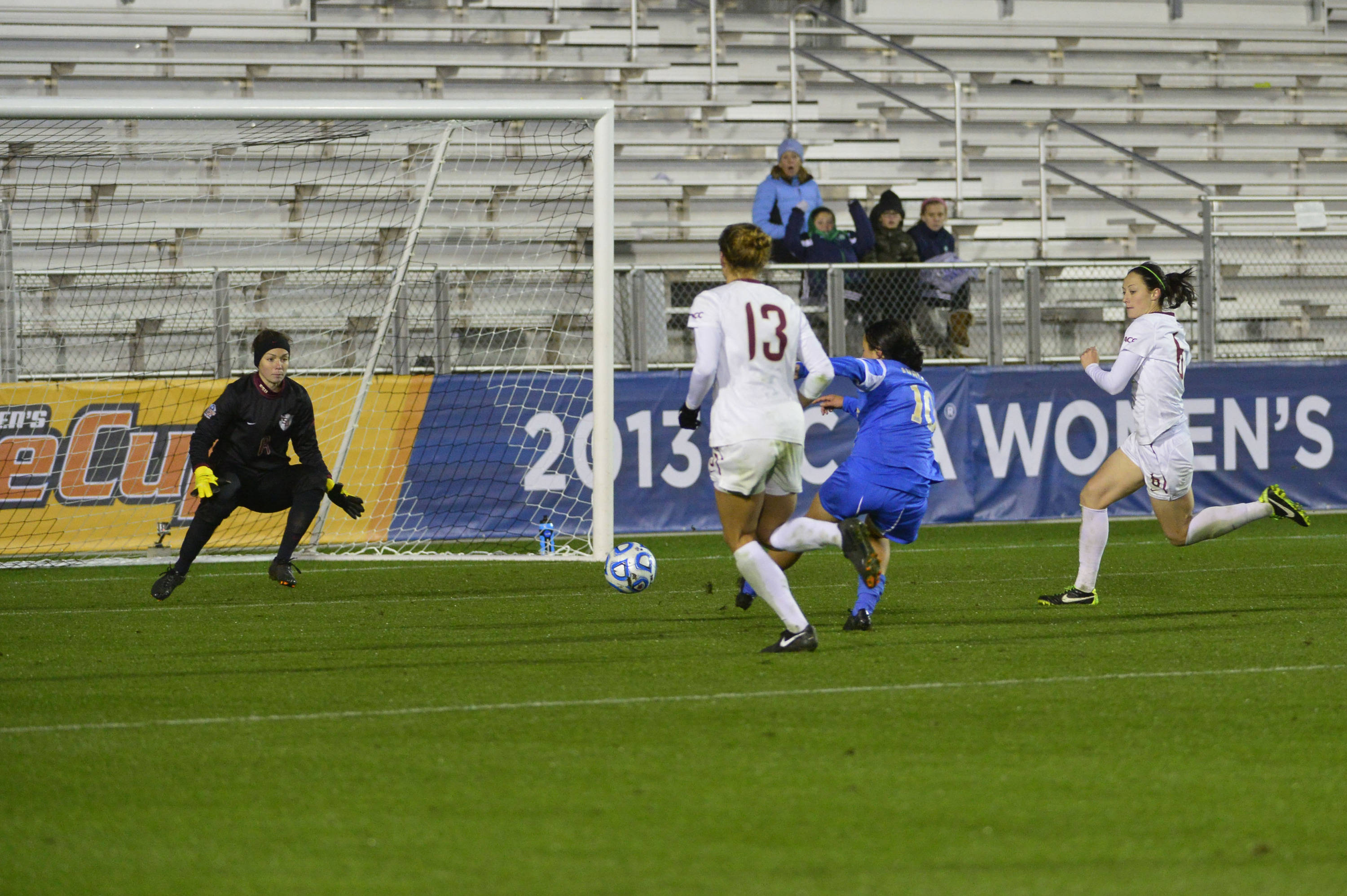 Dec 8, 2013; Cary, NC, USA; UCLA Bruins forward Kodi Lavrusky (10) scores the game winning goal in overtime as Florida State Seminoles goalkeeper Kelsey Wys (19) and defender/midfielder Kristin Grubka (13) and defender Megan Campbell (6) defend. The Bruins defeated the Seminoles 1-0 in overtime at WakeMed Soccer Park. Mandatory Credit: Bob Donnan-USA TODAY Sports