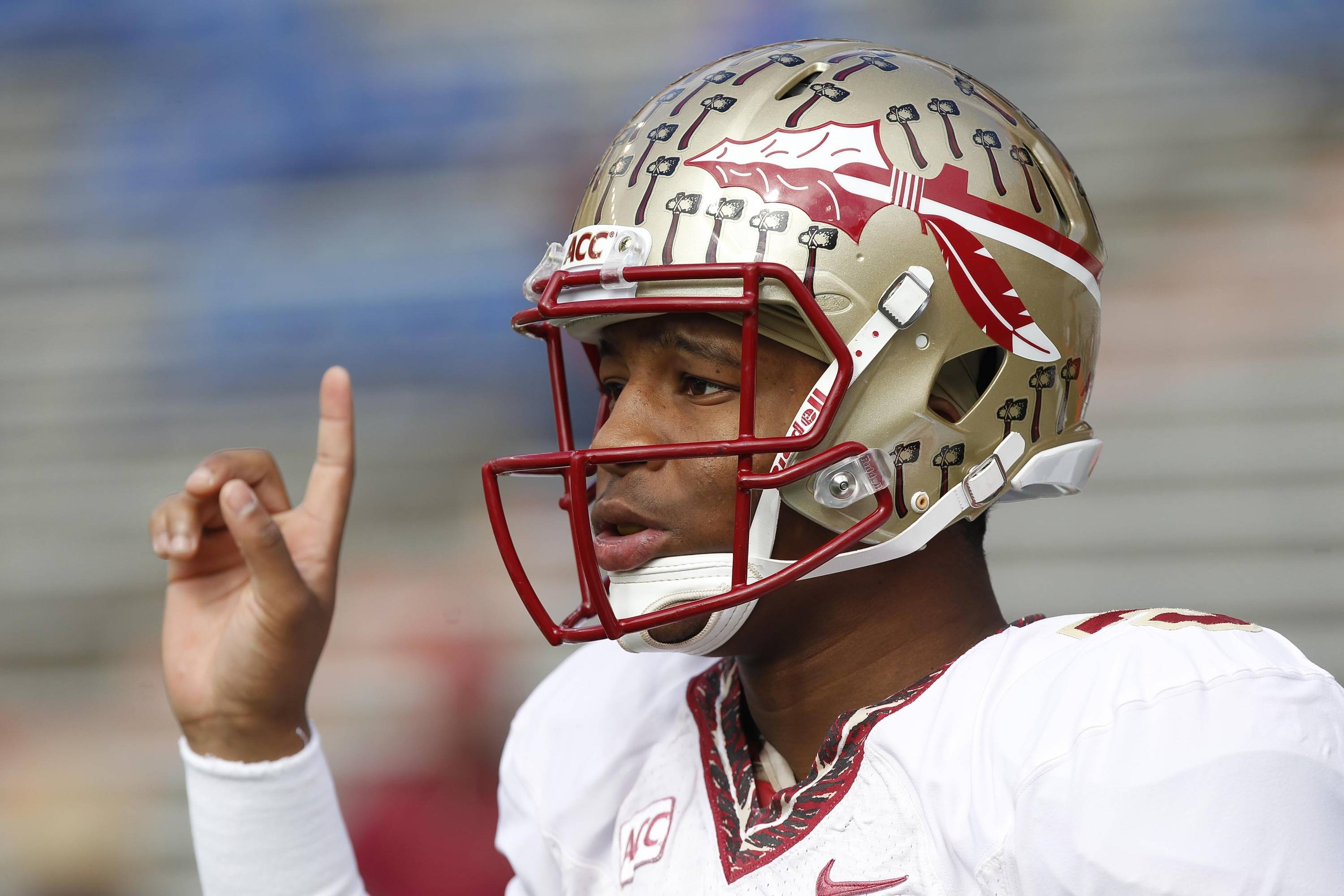 Jameis Winston (5) works out prior to the game. Mandatory Credit: Kim Klement-USA TODAY Sports