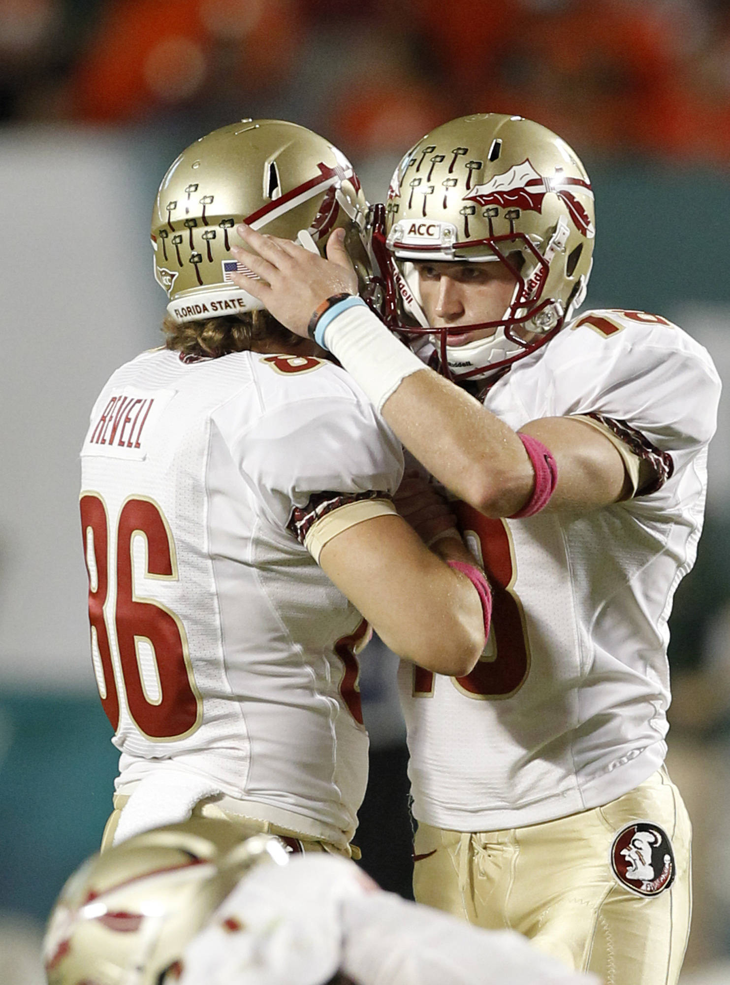 Florida State kicker Dustin Hopkins (18) is congratulated by teammate Chris Revell (86) after scoring a field goal against Miami during the first half of an NCAA college football game in Miami, Saturday, Oct. 20, 2012. (AP Photo/Alan Diaz)