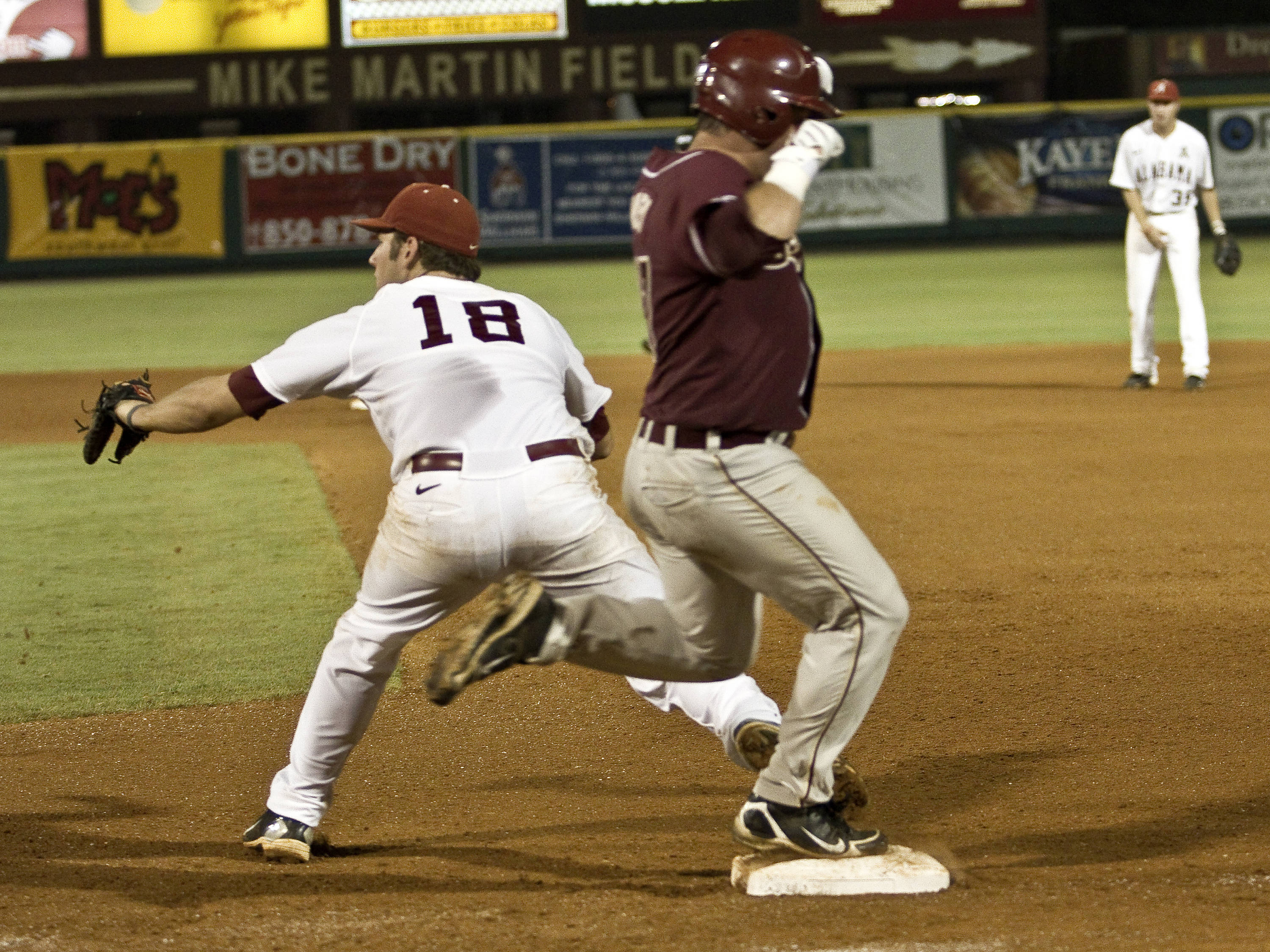 Outfielder Stuart Tapley (27) beating out an infield hit