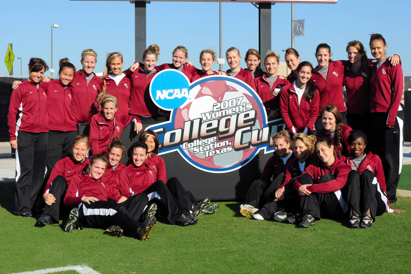 The 2007 Seminoles gather around the College Cup logo inside the Aggie Soccer Complex