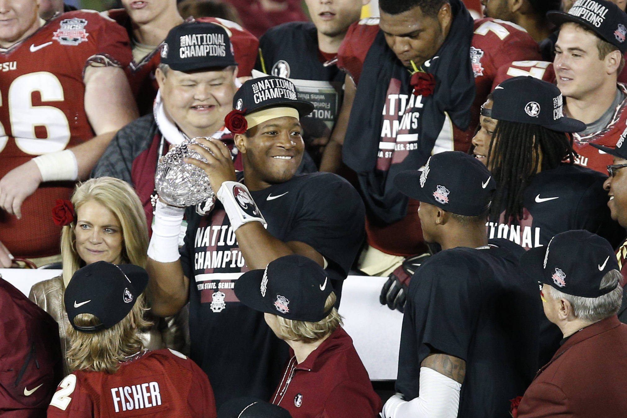 Jan 6, 2014; Pasadena, CA, USA; Florida State Seminoles quarterback Jameis Winston (5) holds the Coaches Trophy after defeating the Auburn Tigers 34-31 in the 2014 BCS National Championship game at the Rose Bowl.  Mandatory Credit: Kelvin Kuo-USA TODAY Sports