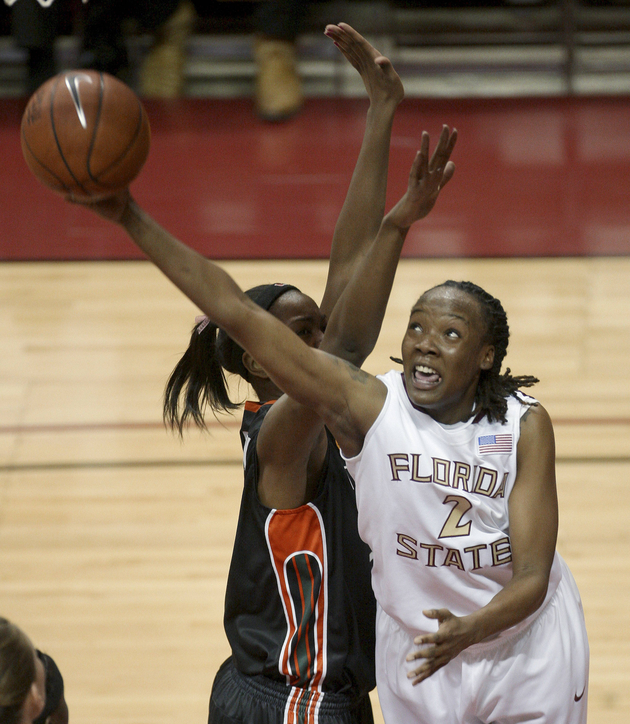 Florida State's Alysha Harvin, right, shoots past Miami's Sylvia Bullock during an NCAA college basketball game Thursday, Feb. 25, 2010, in Tallahassee, Fla. (AP Photo/Phil Coale)