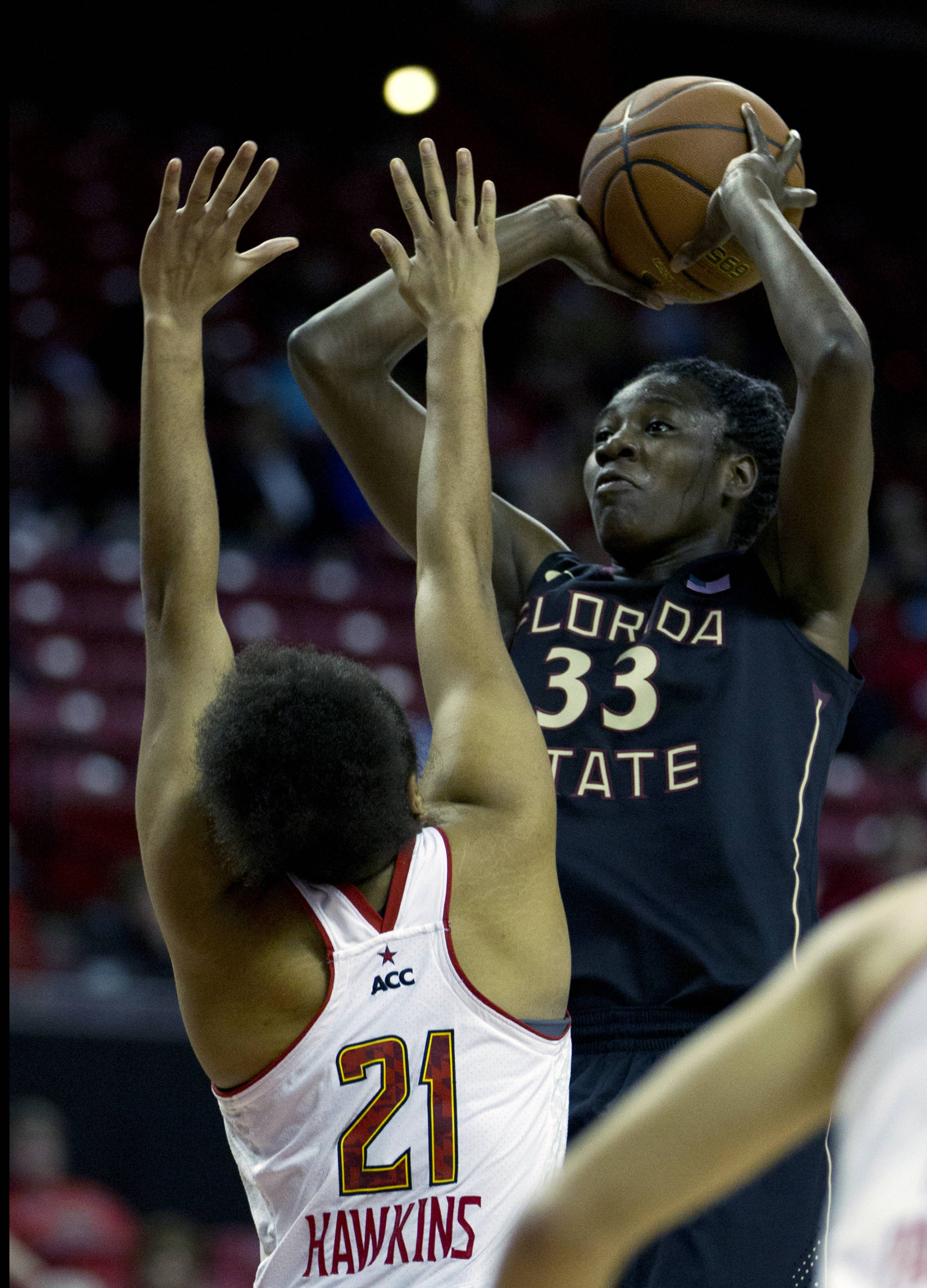 Florida State's Natasha Howard (33) shoots as Maryland's Tianna Hawkins (21) tries to block her during the first half. (AP Photo/Jose Luis Magana)
