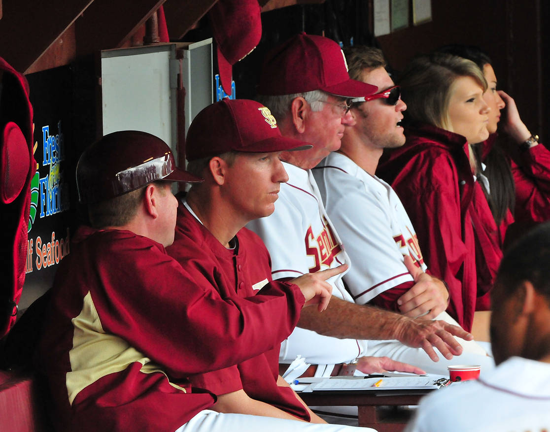 Assistant coach Mike Martin, Jr., associate head coach Mike Bell and head coach Mike Martin in the dugout.