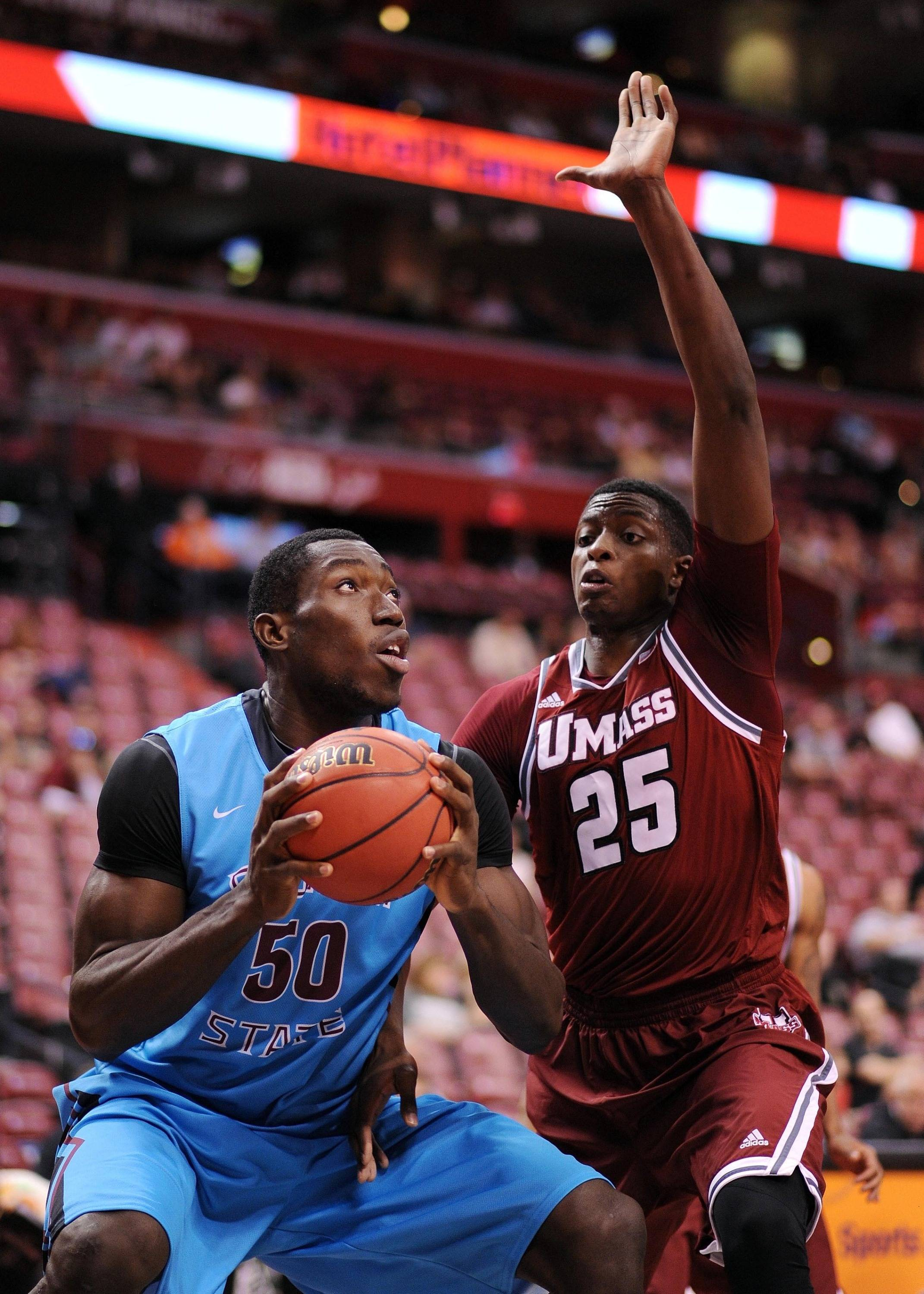 Dec 21, 2013; Sunrise, FL, USA; Florida State Seminoles center Michael Ojo (50) is pressured by Massachusetts Minutemen center Candy Lalanne (25) during the first half at BB&T Center. Mandatory Credit: Steve Mitchell-USA TODAY Sports
