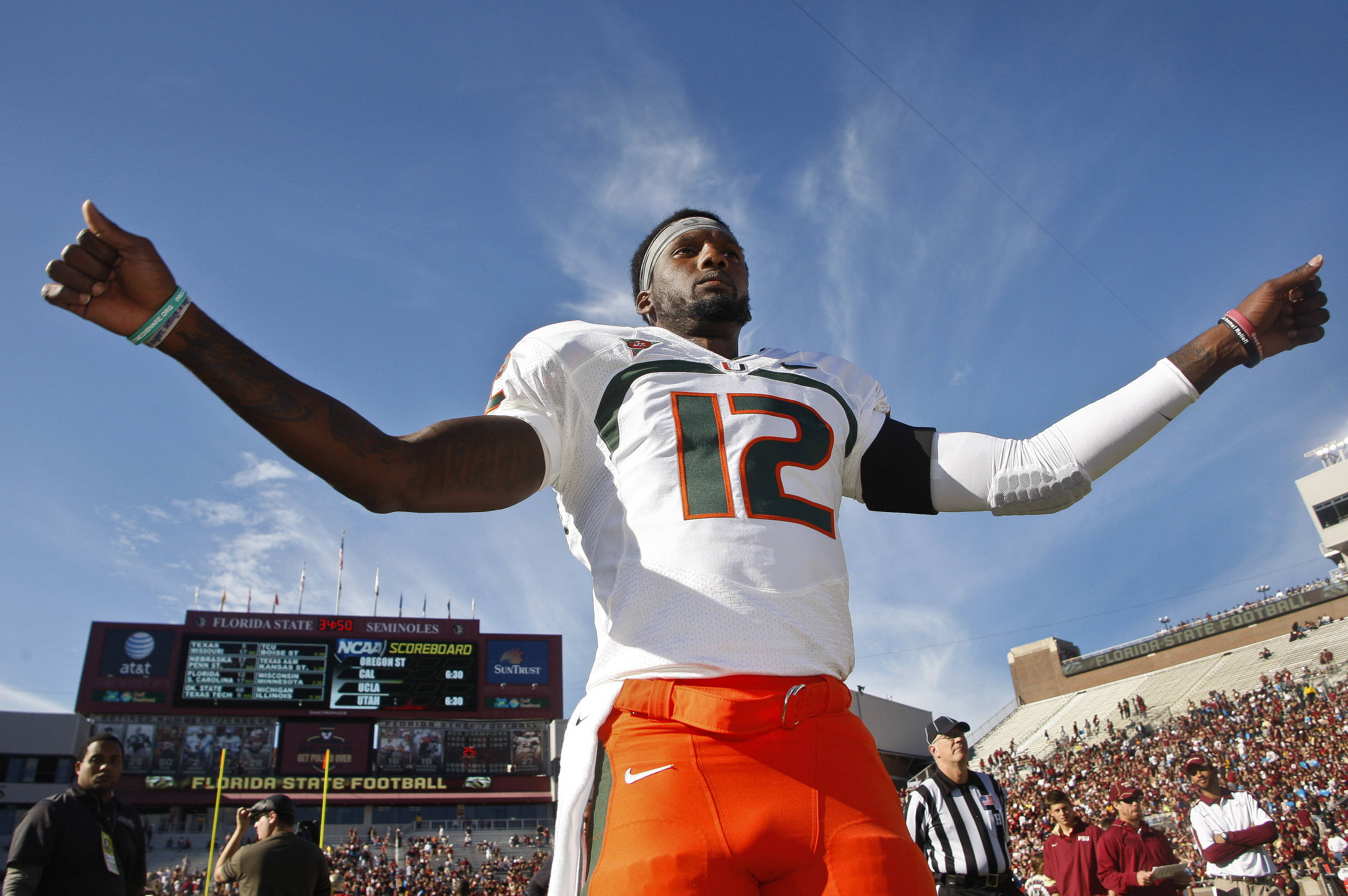 Miami quarterback Jacory Harris (12) stretches prior to an NCAA college football game against Florida State on Saturday, Nov. 12, 2011, in Tallahassee, Fla. (AP Photo/Phil Sears)