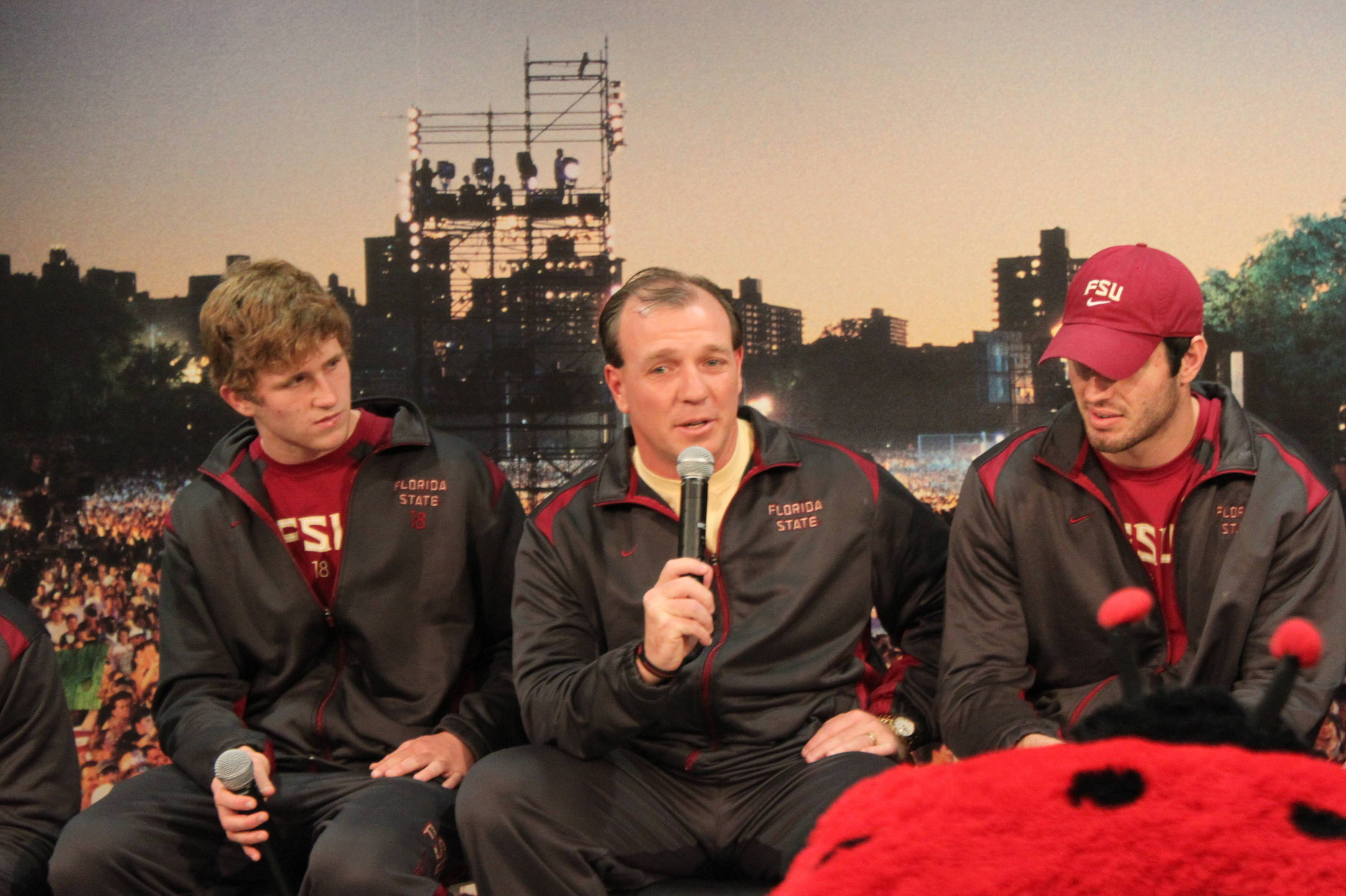 Jimbo Fisher answers questions from a group of children.