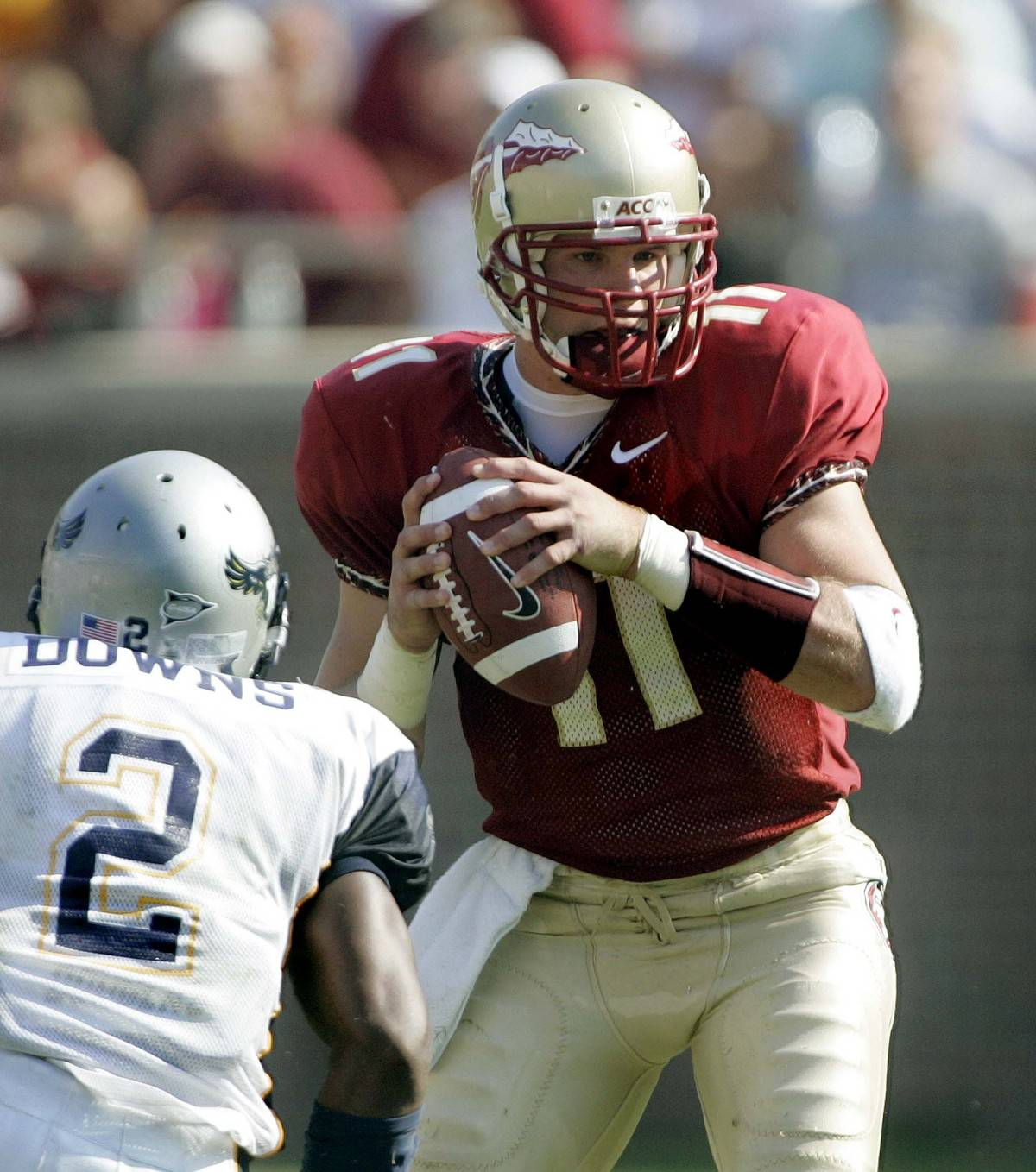 Florida State quarterback Drew Weatherford, right, is pressured by Rice's Andray Downs, left, during the second quarter of an college football game, Saturday, Sept. 23, 2006, in Tallahassee, Fla.(AP Photo/Phil Coale)