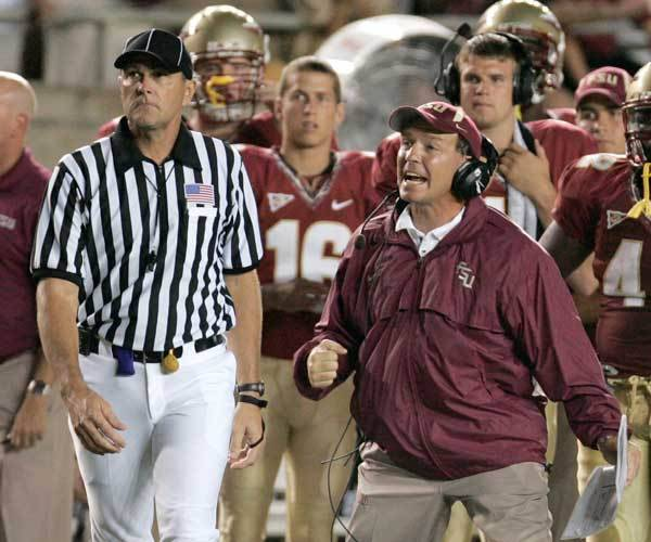 Florida State offensive coordinator Jimbo Fisher, right, yells on the field during the second quarter.