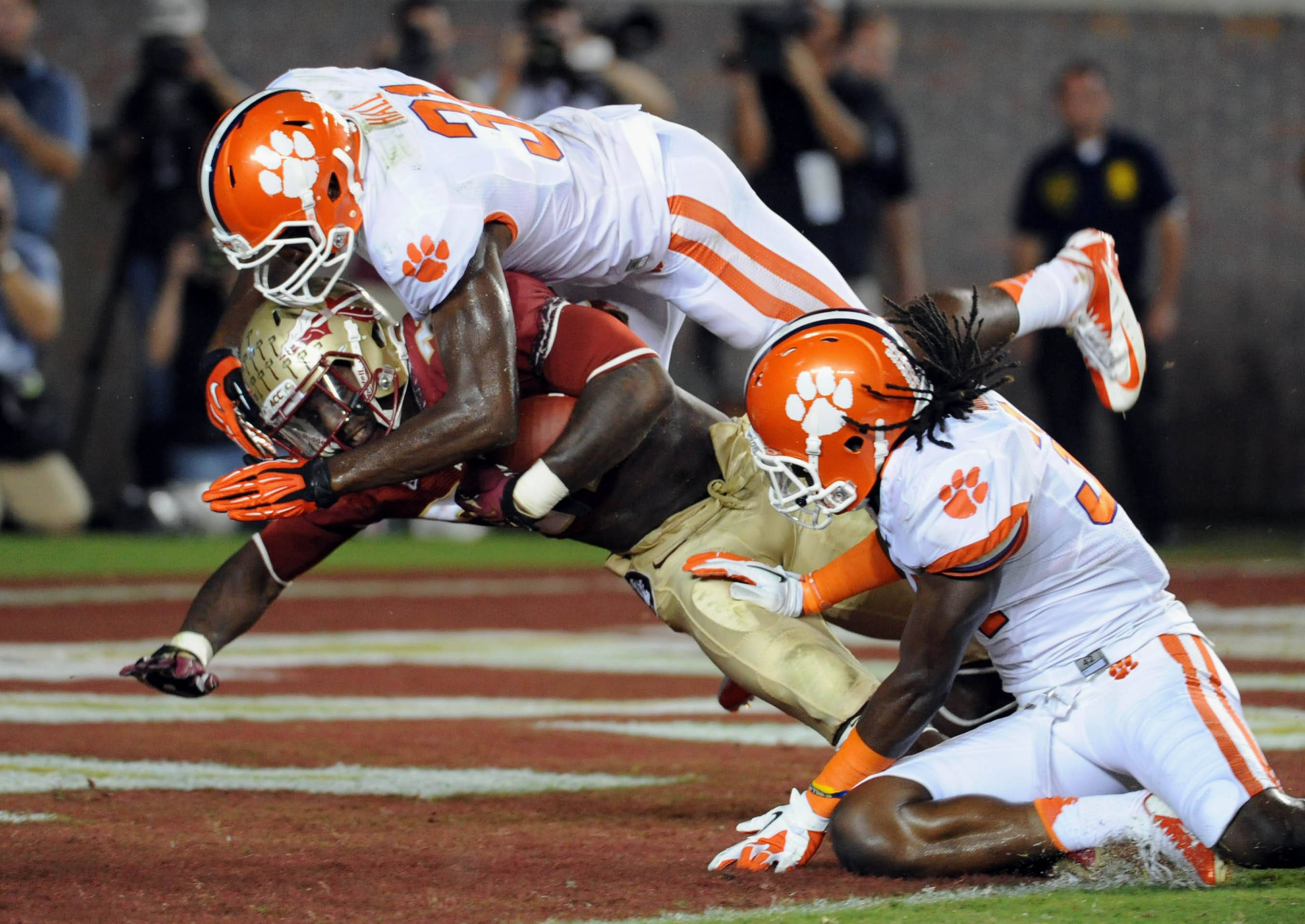 Sept 22, 2012;  Tallahassee, Florida, USA; Florida State Seminoles running back James Wilder Jr. (32) scores a touchdown past Clemson Tigers safety Rashard Hall (31) during the first half of the game at Doak Campbell Stadium. Mandatory Credit: Melina Vastola-USA TODAY Sports