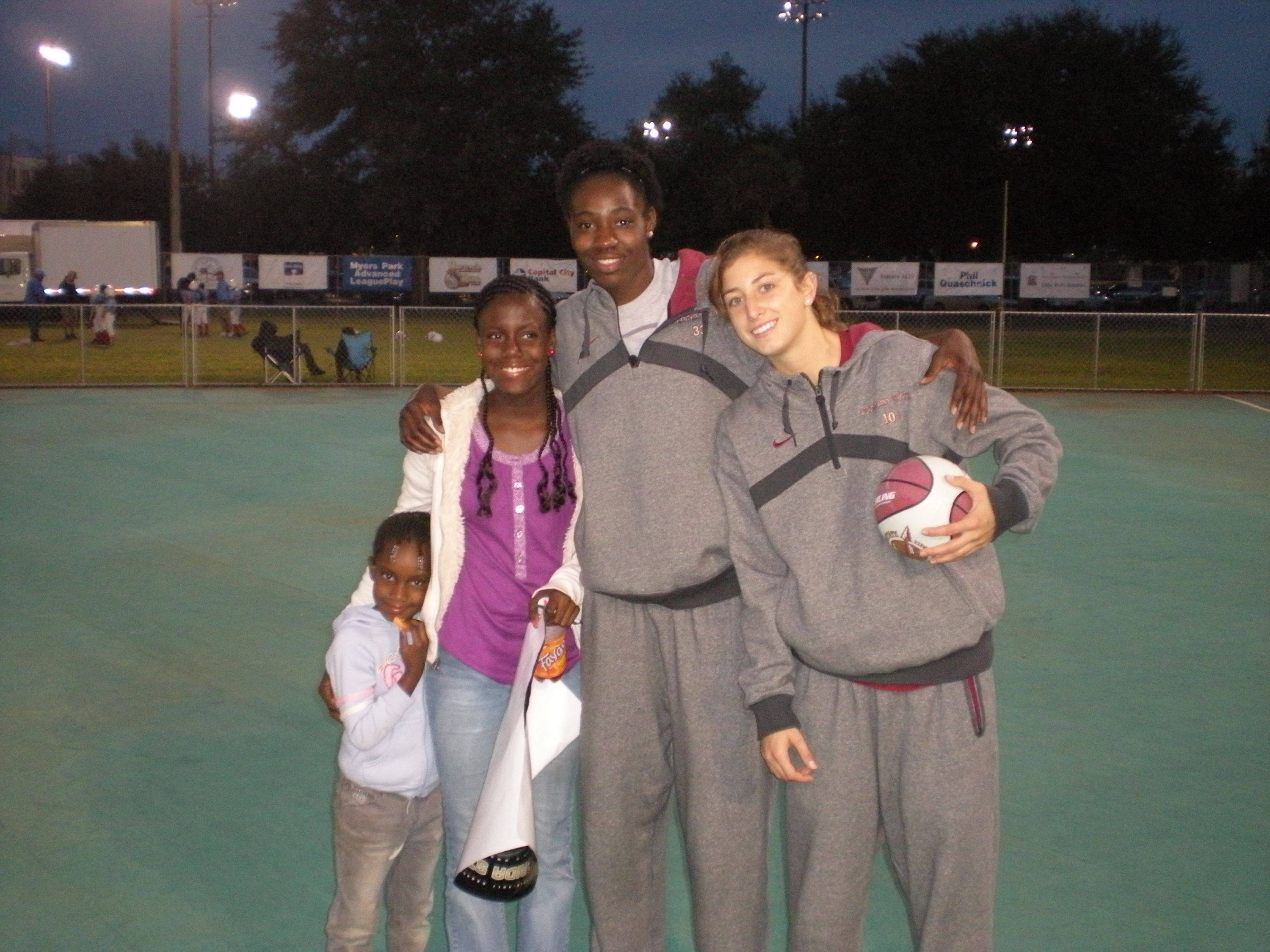Natasha Howard and Leonor Rodriguez pose for a photo with some local Tallahassee youngsters.