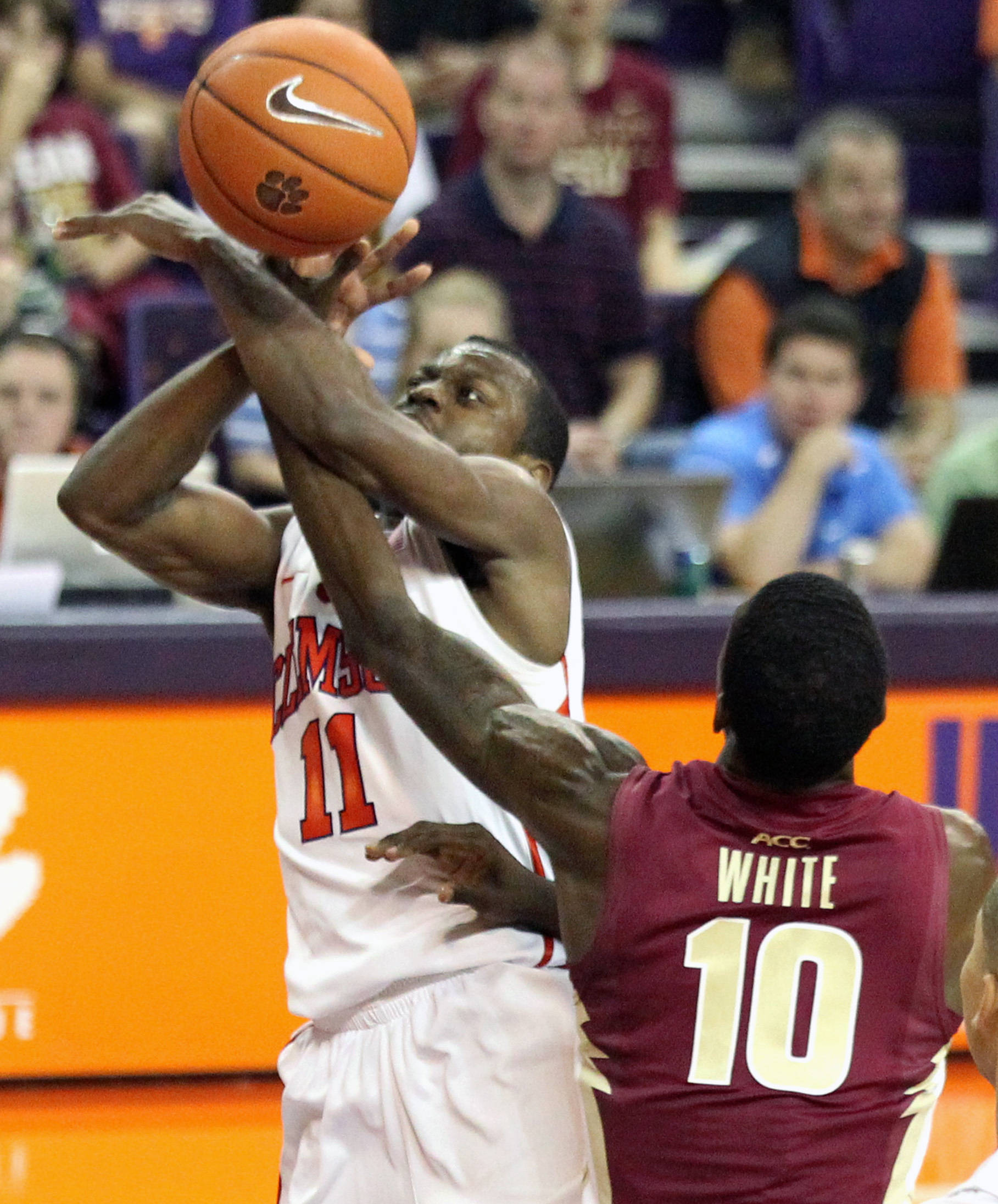 Clemson's Andre Young, left, is fouled by Florida State's Okaro White (10) during the second half. (AP Photo/Anderson Independent-Mail, Mark Crammer)