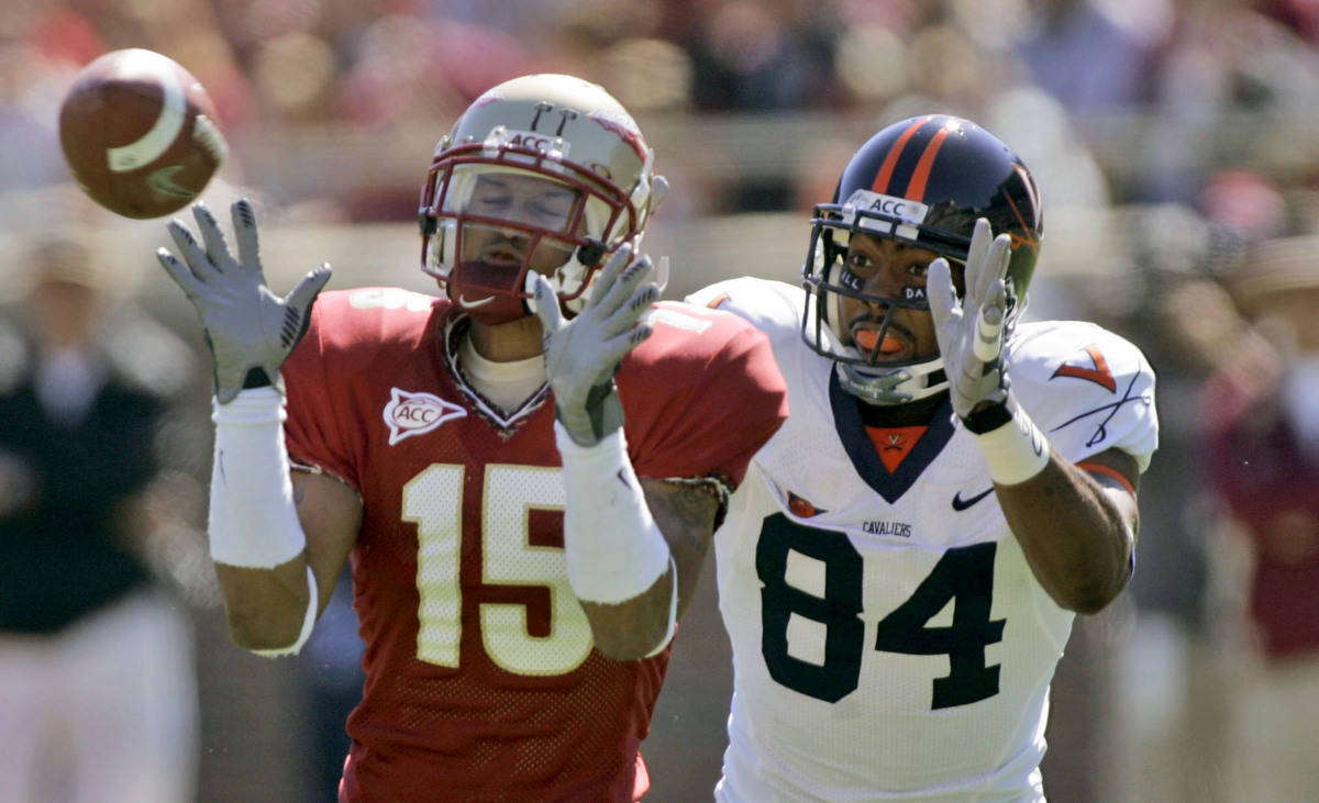 Florida State defensive back Tony Carter, left, intercepts a first-quarter pass intended for Virginia receiver, Fontel Mines, right, during a college football game, Saturday, Nov. 4, 2006, in Tallahassee, Fla. Carter returned the interception for a touchdown. (AP Photo/Phil Coale)