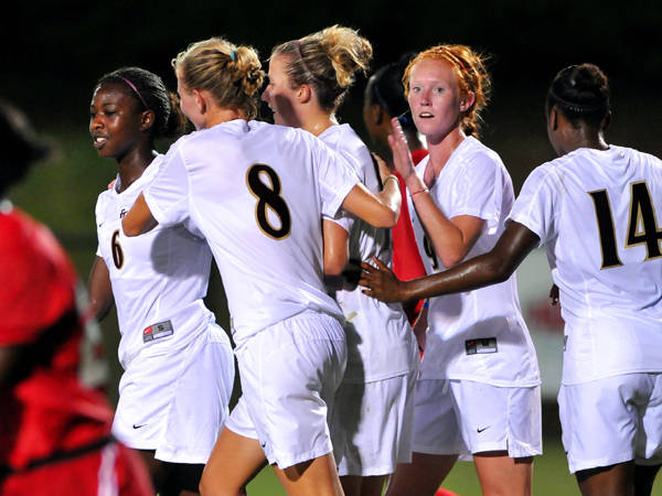 The Seminoles celebrate after scoring on Friday night against South Alabama.