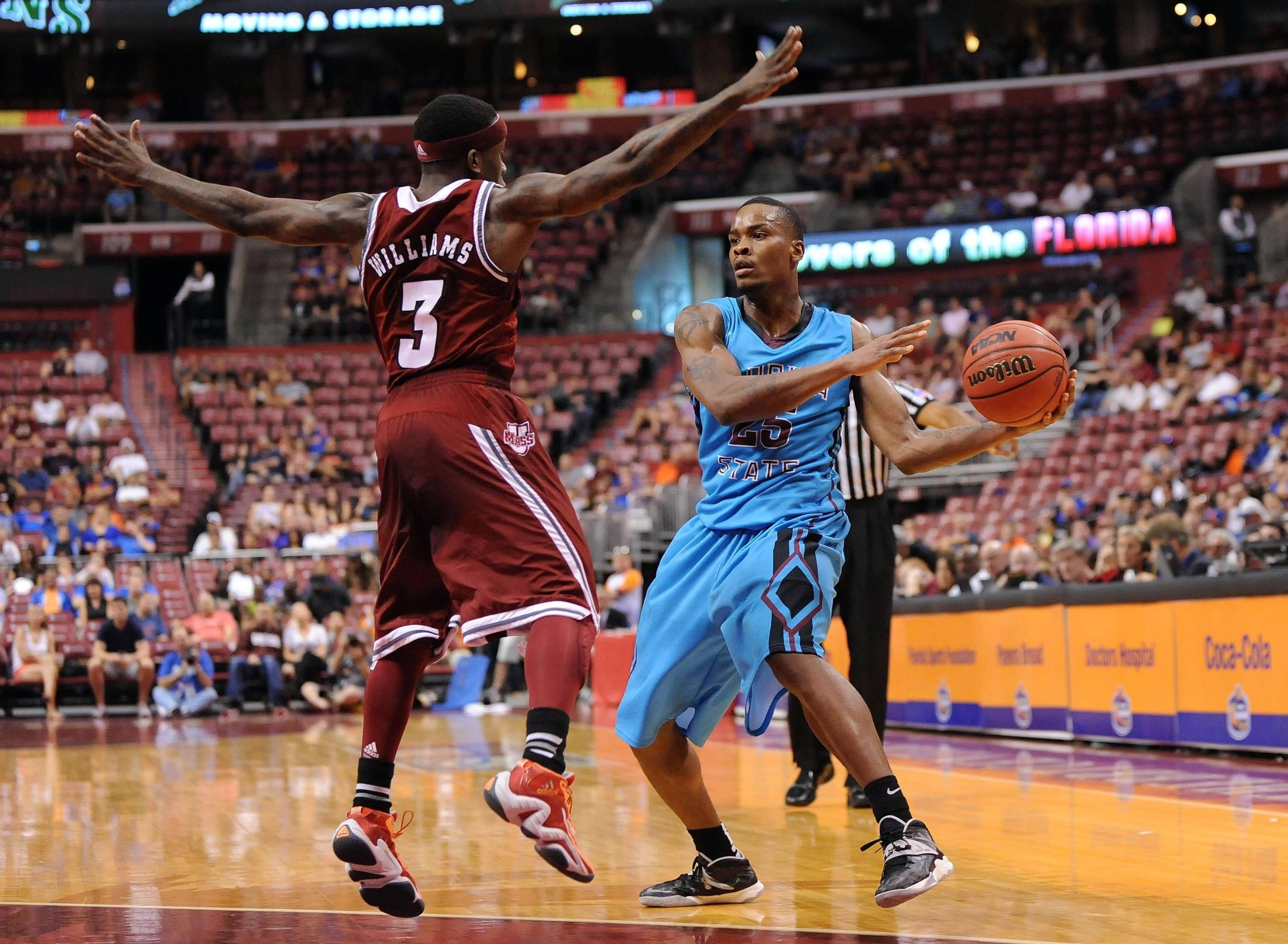 Dec 21, 2013; Sunrise, FL, USA; Florida State Seminoles guard Aaron Thomas (25) passes the ball past Massachusetts Minutemen guard Chaz Williams (3) during the second half at BB&T Center. Mandatory Credit: Steve Mitchell-USA TODAY Sports