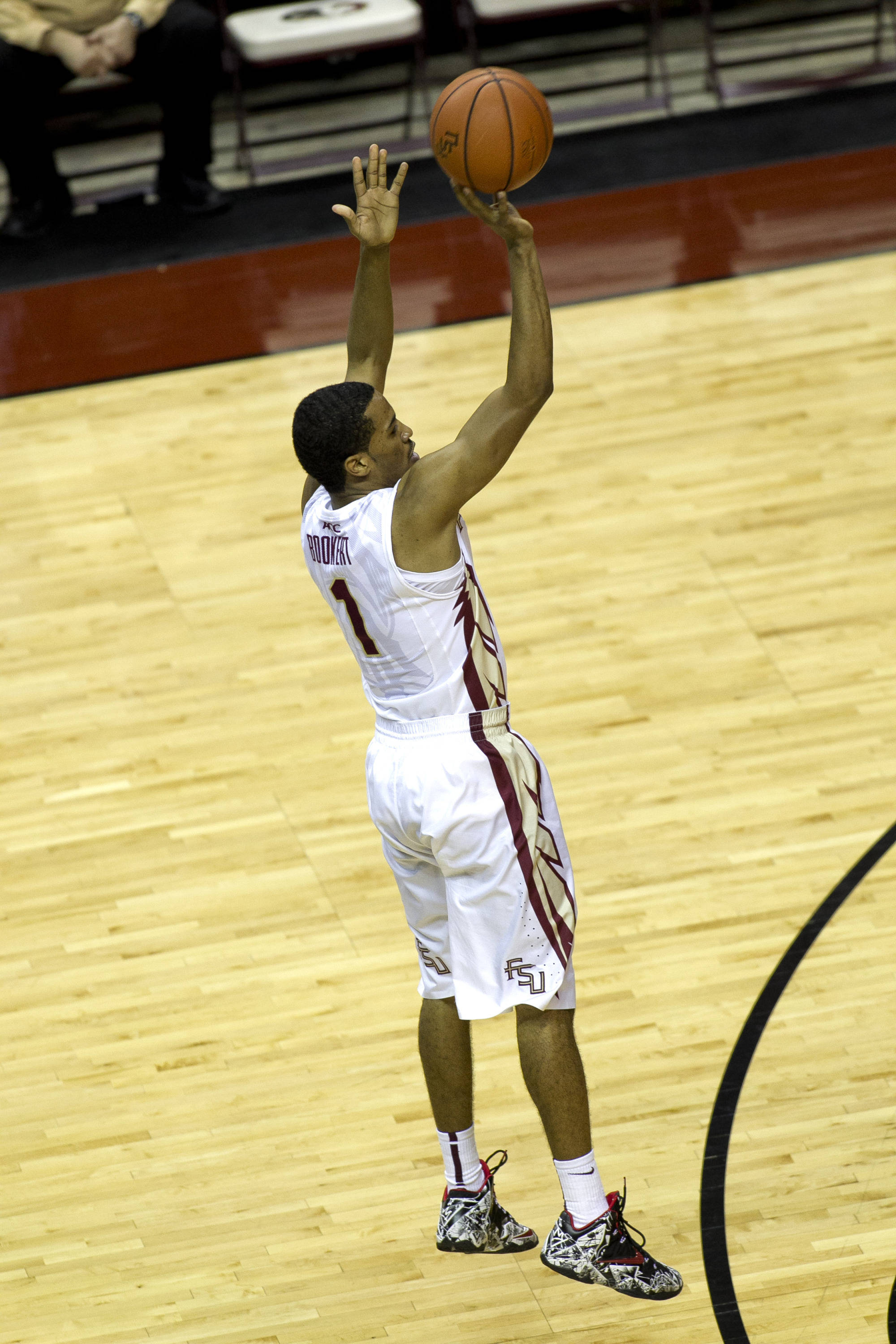 Devon Bookert (1) releases a jumper from the top of the key, FSU vs Miami, 2-10-14, (Photo's by Steve Musco)
