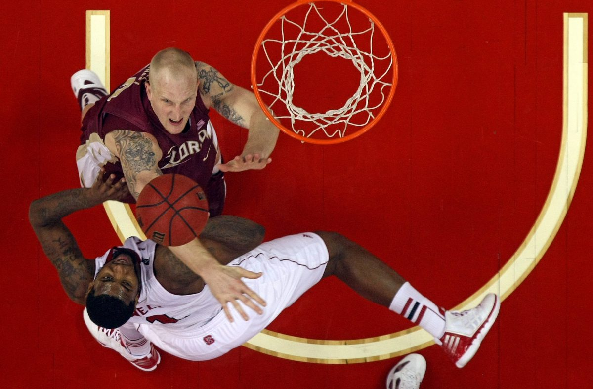Florida State's Jon Kreft (50) blocks the shot of North Carolina State's Richard Howell (1) during the first half of an NCAA college basketball game in Raleigh, N.C., Saturday, Feb. 18, 2012. Florida State won 76-62. (AP Photo/Karl B DeBlaker)