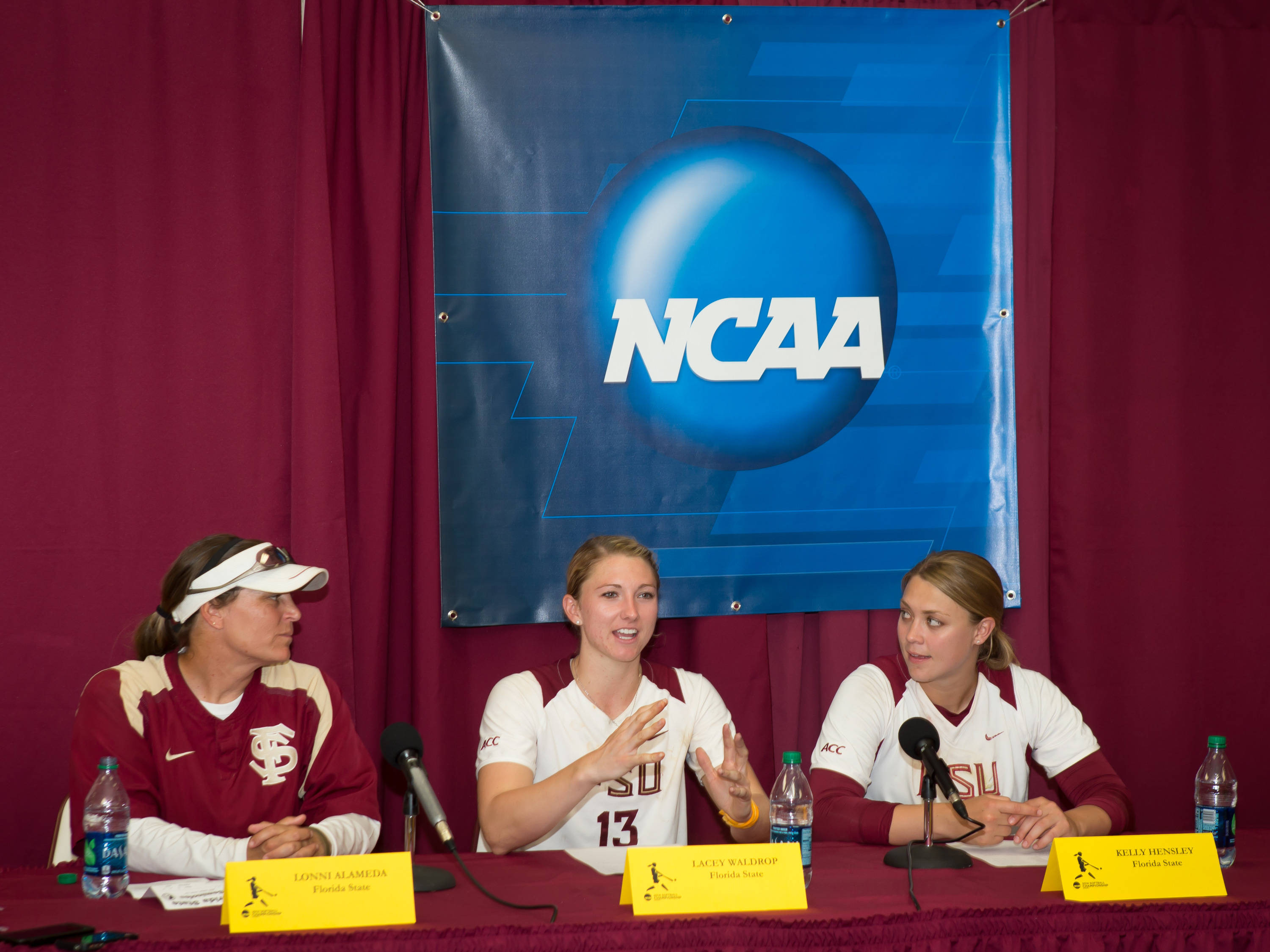 Lonni Alameda, Lacey Waldrop (13), Kelly Hensley (23) participate in the post game interview.