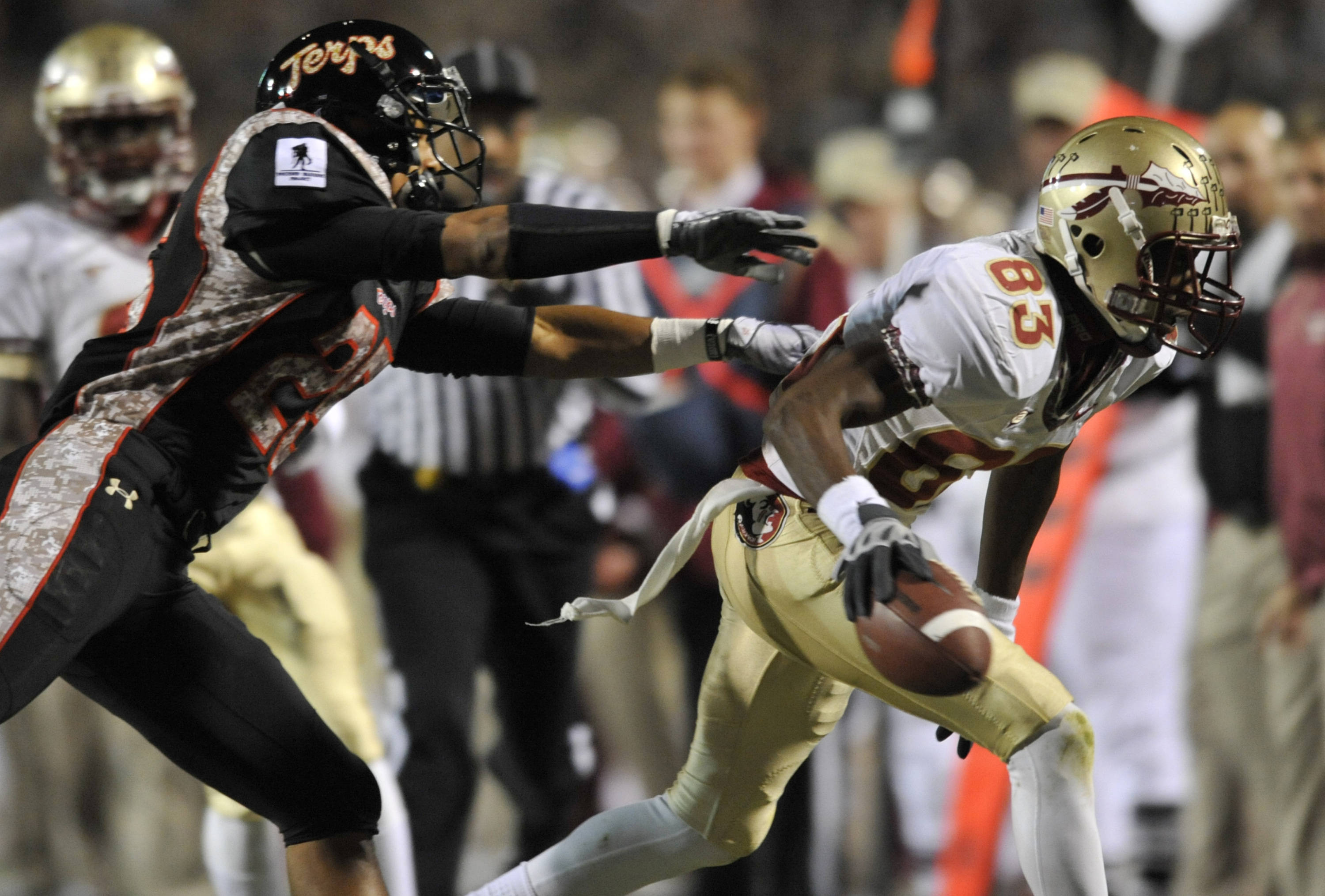 Maryland's Dexter McDougle pushes Florida State's Bert Reed out of bounds during the first half. (AP Photo/Gail Burton)