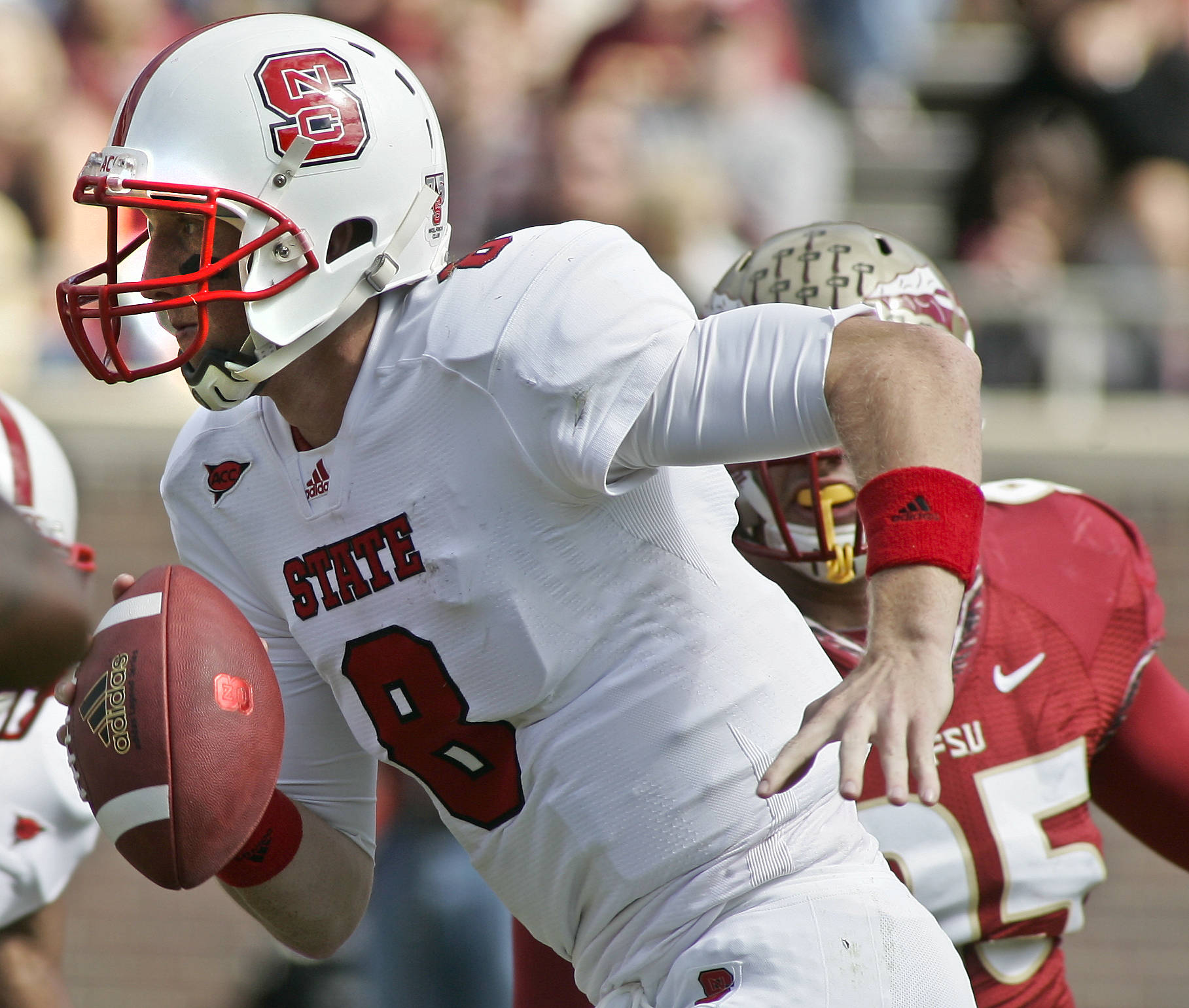 North Carolina State quarterback Mike Glennon (8) scrambles in the first quarter of an NCAA college football game against Florida State at Doak Campbell Stadium in Tallahassee, Fla., Saturday, Oct. 29, 2011. FSU won 34-0. (AP Photo/Phil Sears)
