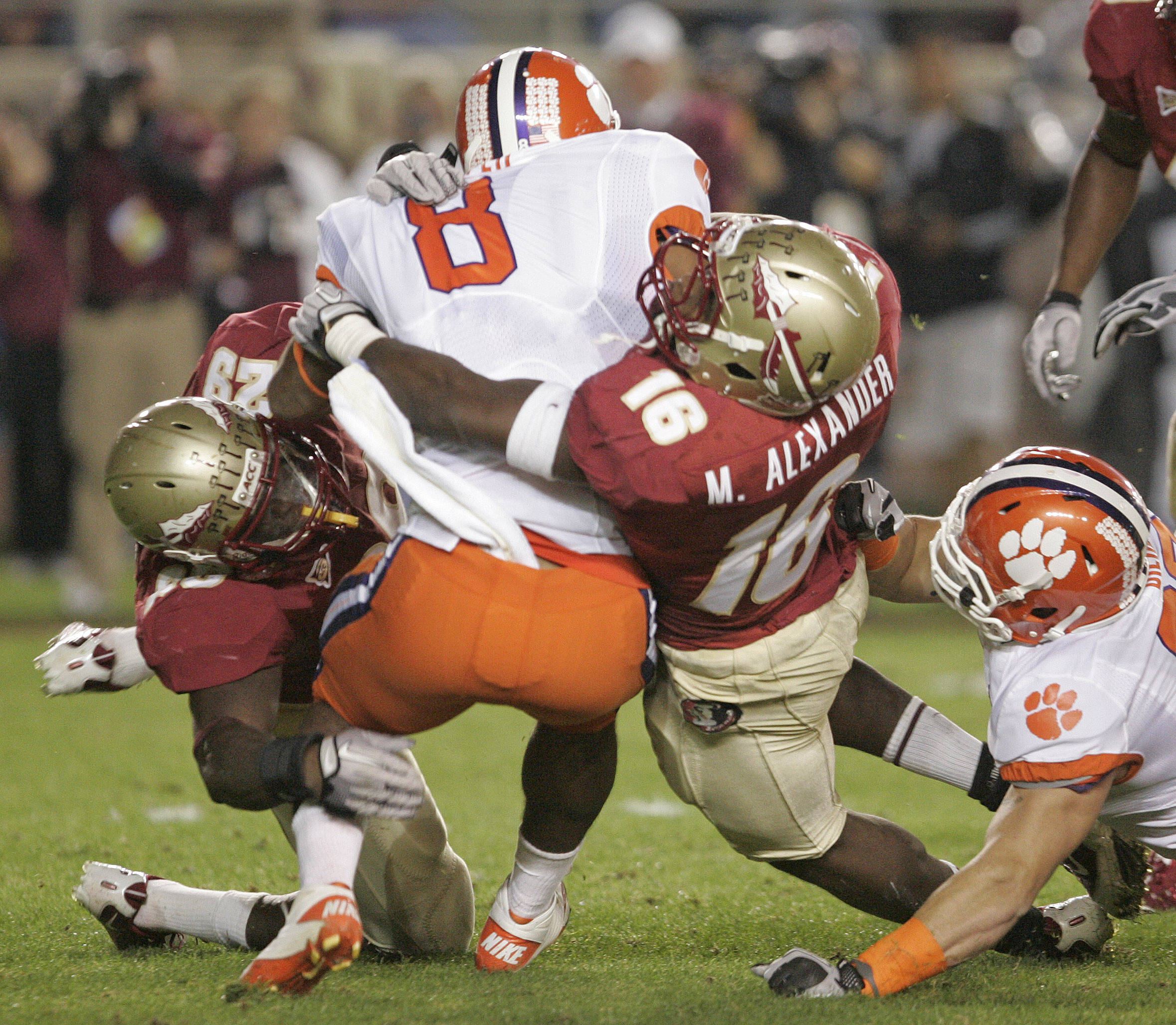 Florida State's Mister Alexander, right and Kendall Smith stop Clemson's Jamie Harper for a short gain in the first quarter of an NCAA college football game on Saturday, Nov. 13, 2010 in Tallahassee, Fla.(AP Photo/Steve Cannon)