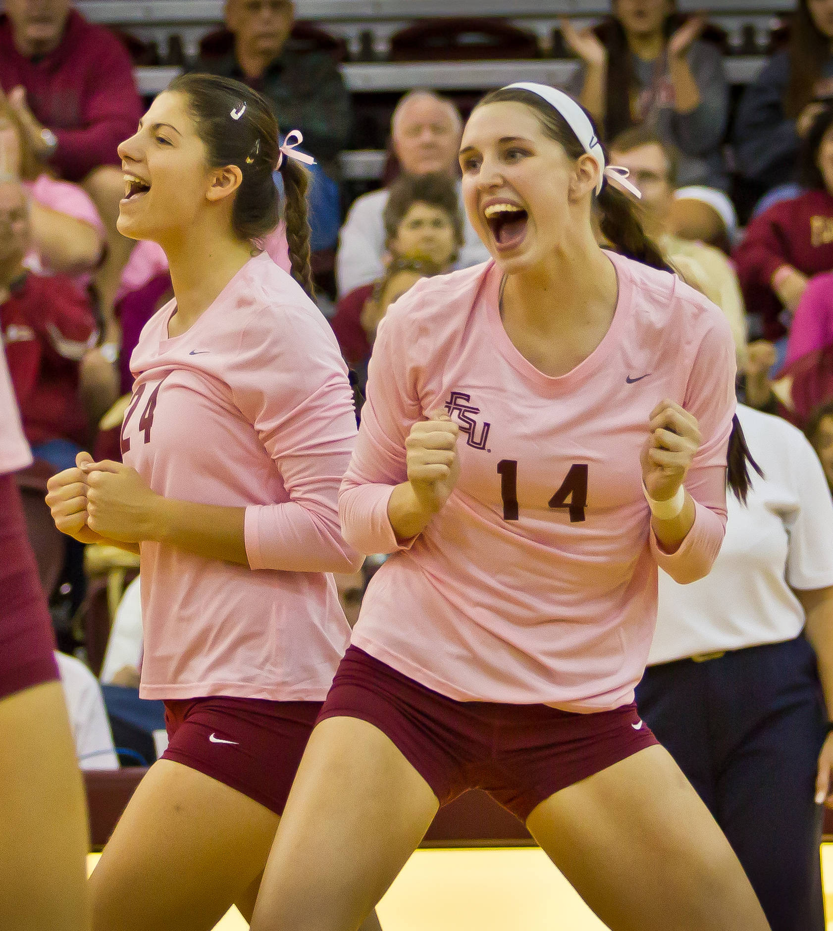 Olivera Medic (24) and Ashley Neff (14) celebrate a point.