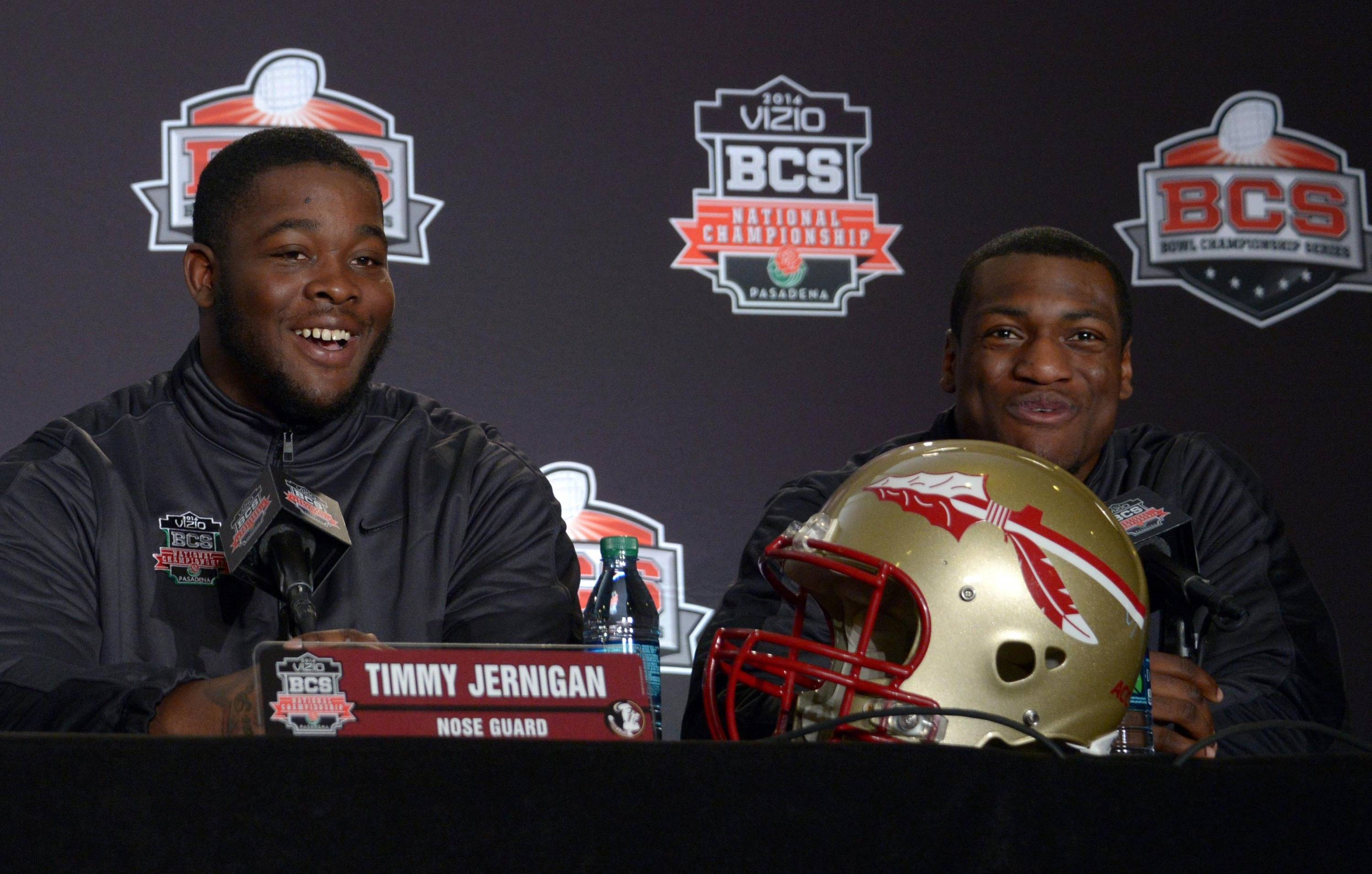 Florida State Seminoles nose guard Timmy Jernigan (left) and linebacker Christian Jones at the 2014 BCS National Championship press conference at Newport Beach Marriott. Mandatory Credit: Kirby Lee-USA TODAY Sports