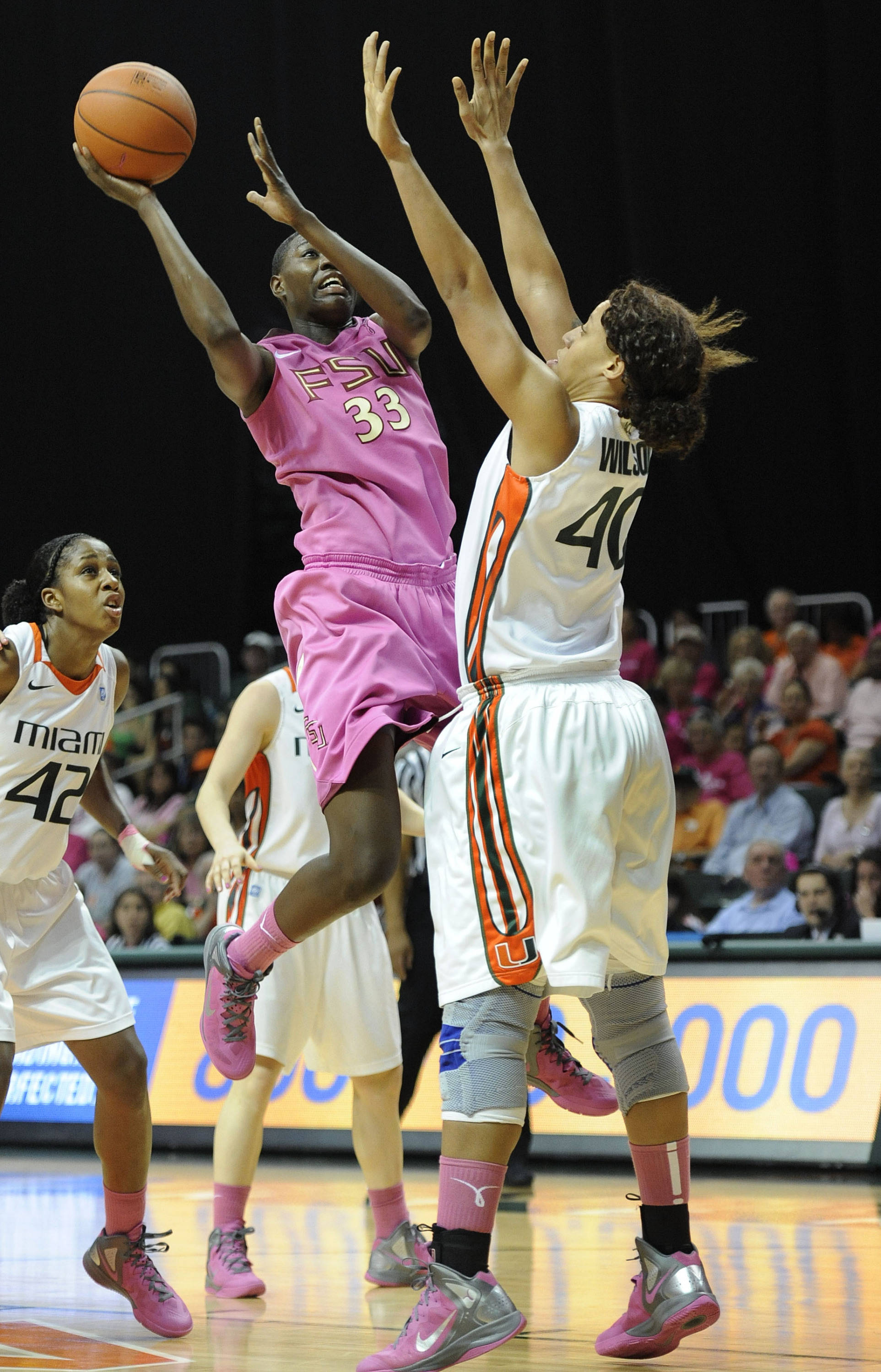 Florida State's Natasha Howard, left, shoots around the defense of Miami's Shawnice Wilson, right, during the second half of an NCAA college basketball game on Sunday, Feb. 19, 2012, in Coral Gables, Fla. Miami defeated Florida State 67-60. (AP Photo/Rhona Wise)