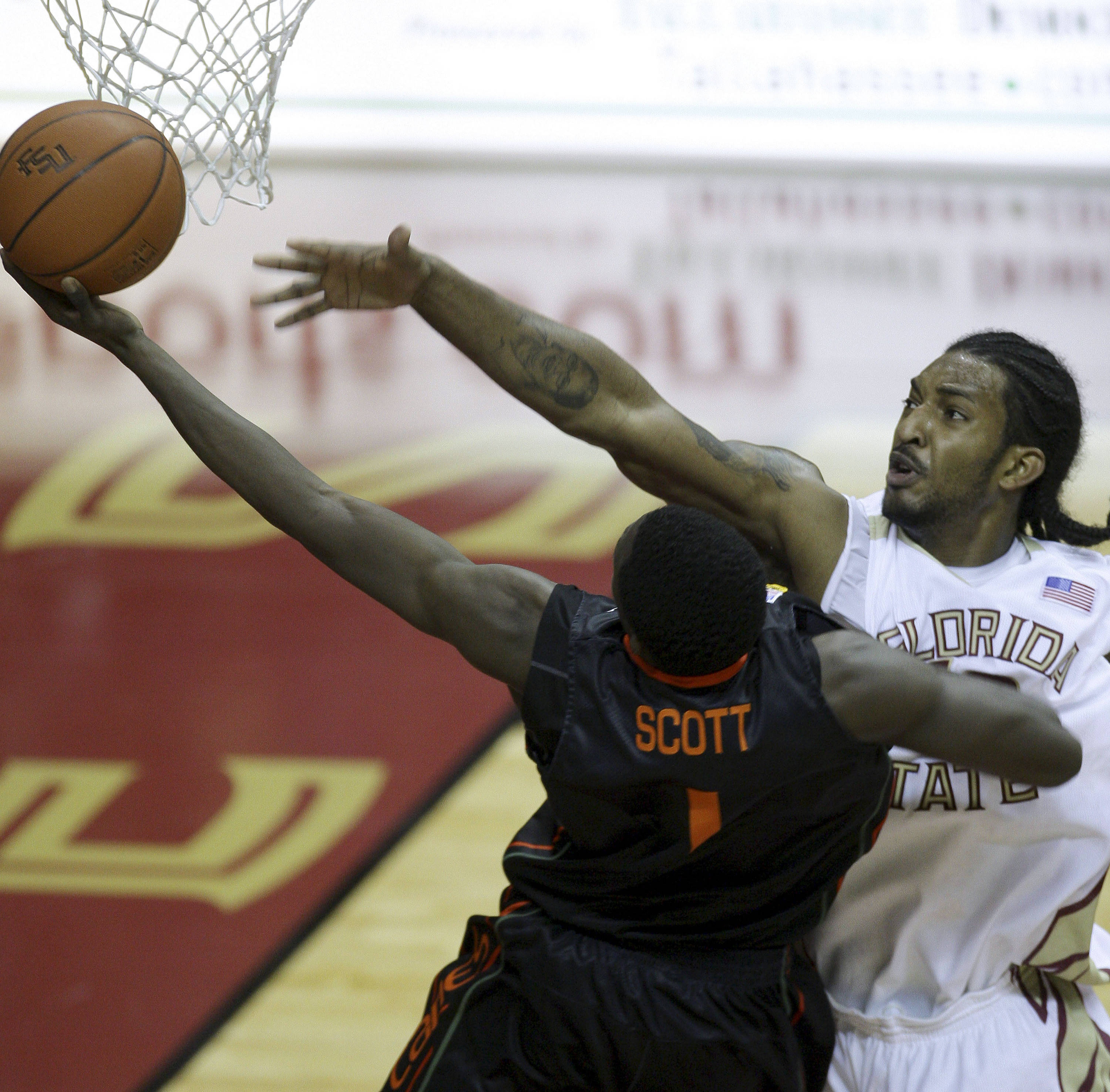 Florida State's Ryan Reid, right, fouls Miami's Durand Scott during the first half of an NCAA college basketball game, Saturday, Feb. 6, 2010, in Tallahassee, Fla. (AP Photo/Phil Coale)