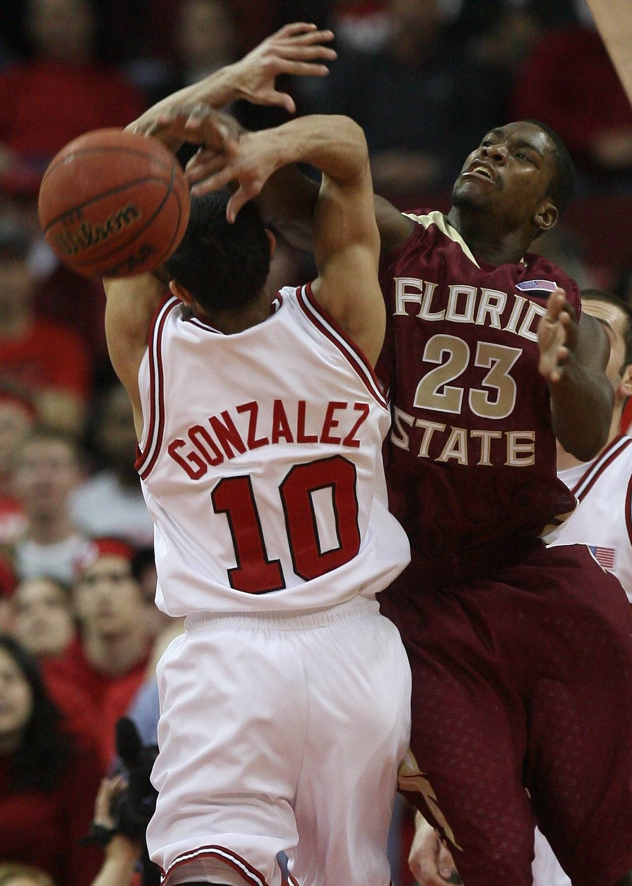 Florida State's Toney Douglas, right, knocks the rebound away from N.C. State's Javier Gonzalez during the first half of N.C. State's game against Florida State University, Wednesday, Feb. 27, 2008, at the RBC Center, in Raleigh, N.C. (AP Photo/The News & Observer,Ethan Hyman)