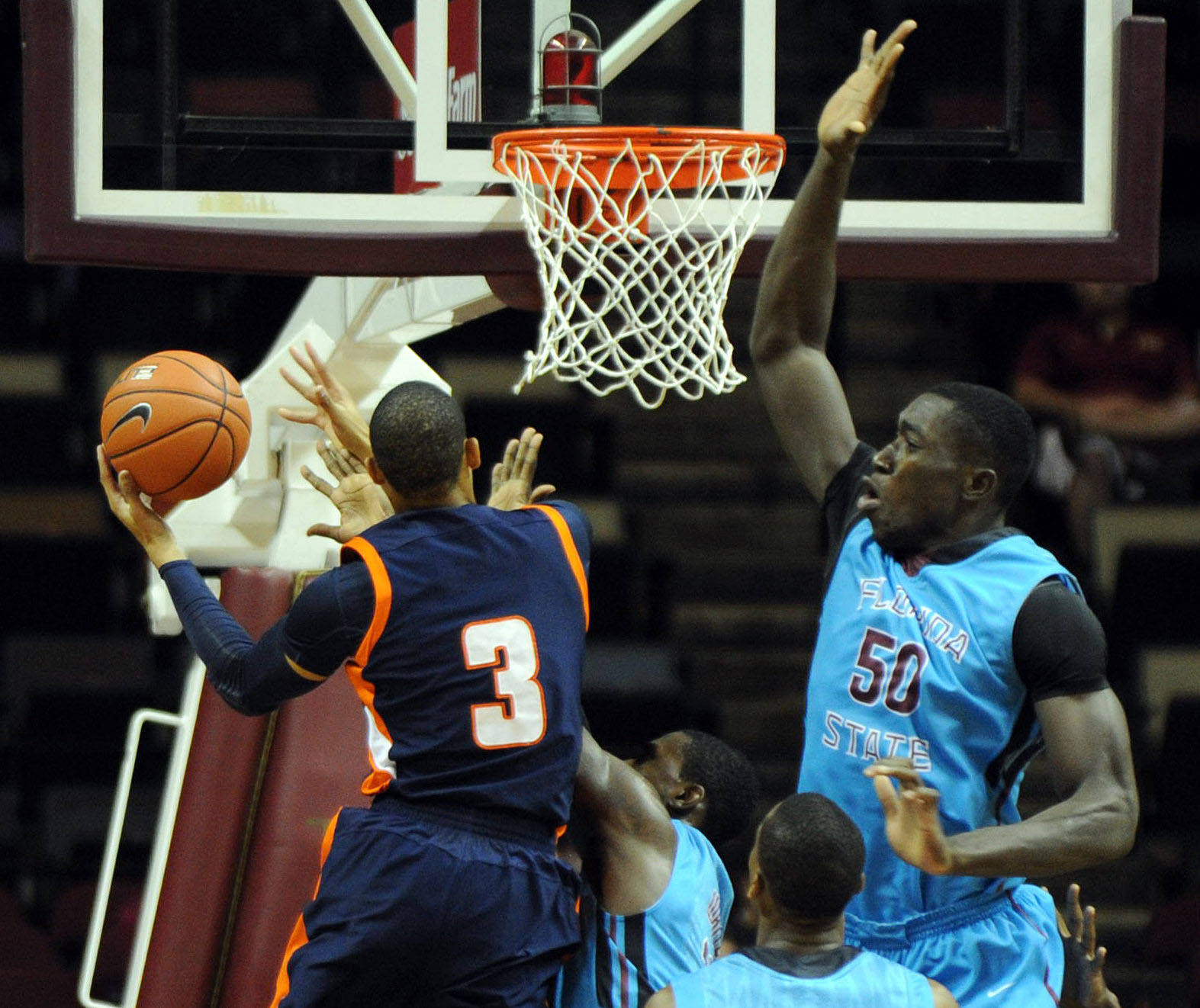 Terence Smith (3) goes up for a shot against defense from Florida State Seminoles center Michael Ojo (50). Mandatory Credit: Melina Vastola-USA TODAY Sports