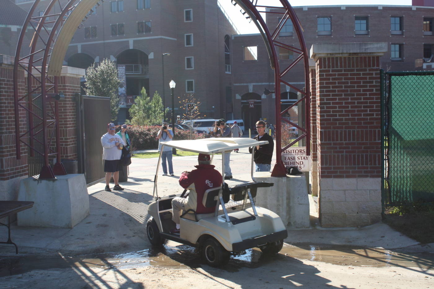 Coach Bowden drives off after practice