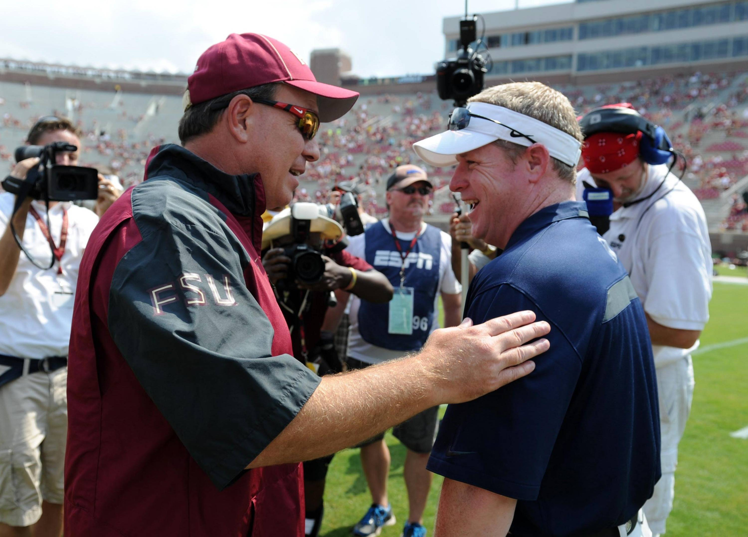 Sep 14, 2013; Tallahassee, FL, USA; Florida State Seminoles head coach Jimbo Fisher greets Nevada Wolf Pack head coach Brian Polian before the game at Doak Campbell Stadium. Mandatory Credit: Melina Vastola-USA TODAY Sports