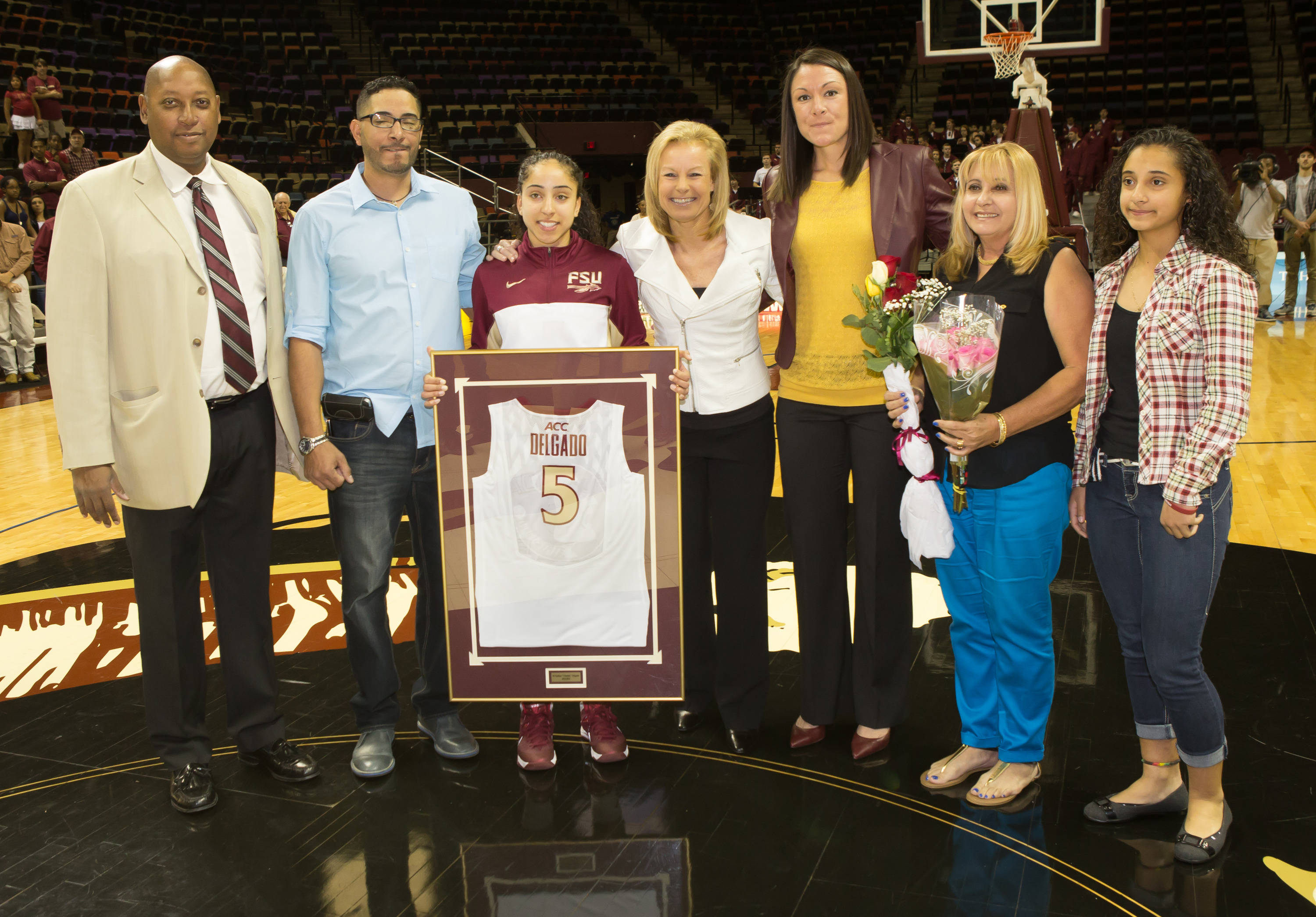 Senior Cheetah Delgado (5) is recognized by AD Stan Wilcox, SWA Vanessa Fuchs, and Coach Sue Semrau.