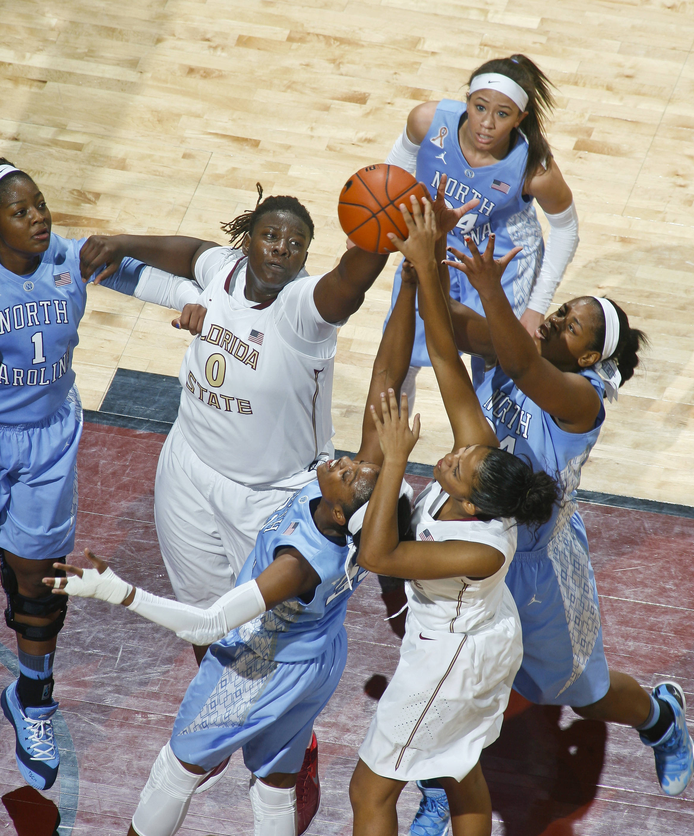 Jan 12, 2014; Tallahassee, FL, USA; Florida State Seminoles forward Kai James (0) and North Carolina Tar Heels guard Diamond DeShields (23) and Florida State Seminoles guard Emiah Bingley (3) and North Carolina Tar Heels forward Xylina McDaniel (34) go for a rebound in the first half at the Tucker Center. Mandatory Credit: Phil Sears-USA TODAY Sports