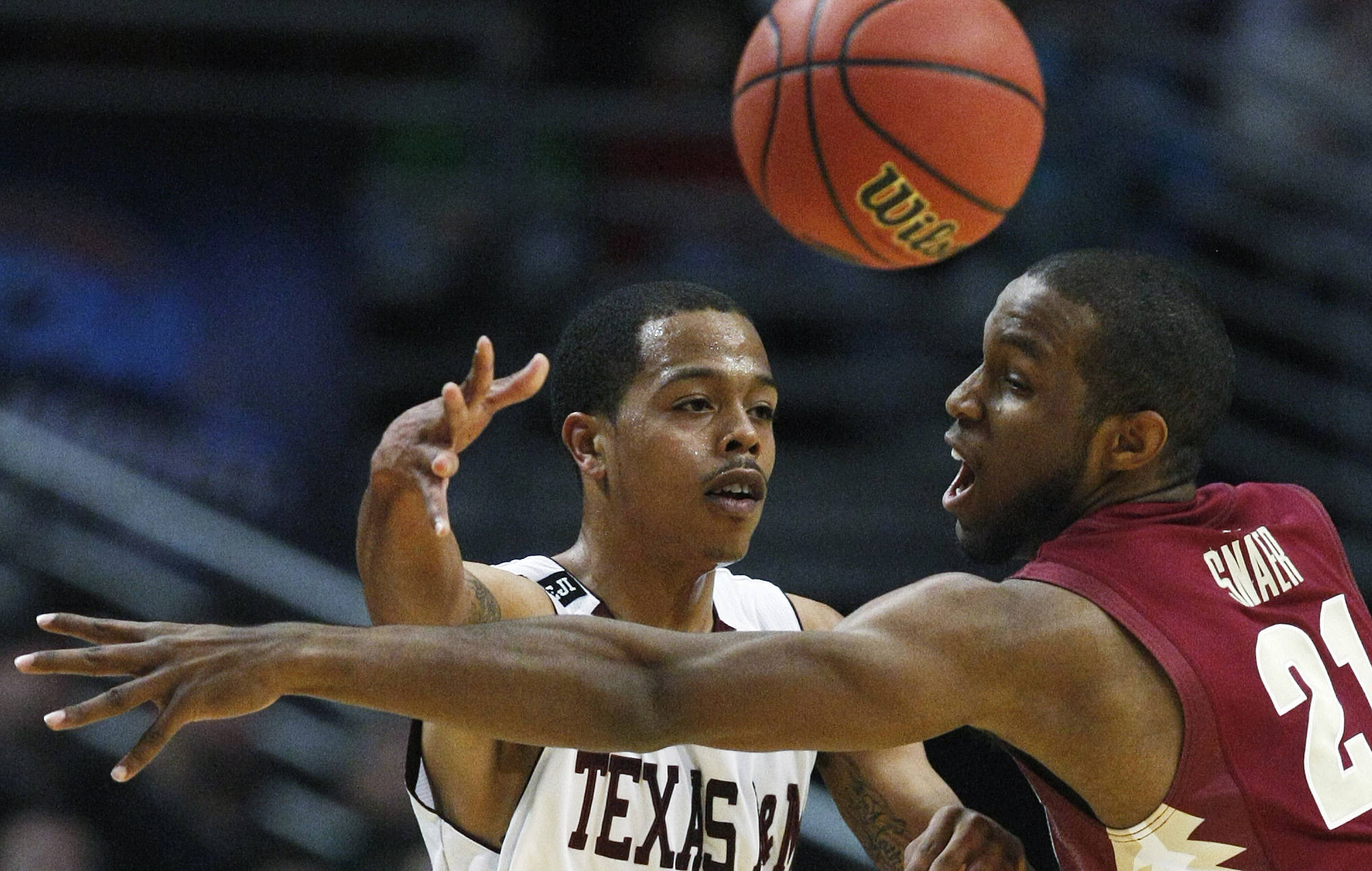 Texas A&M's B.J. Holmes passes the ball past Florida State's Michael Snaer. (AP Photo/Charles Rex Arbogast)