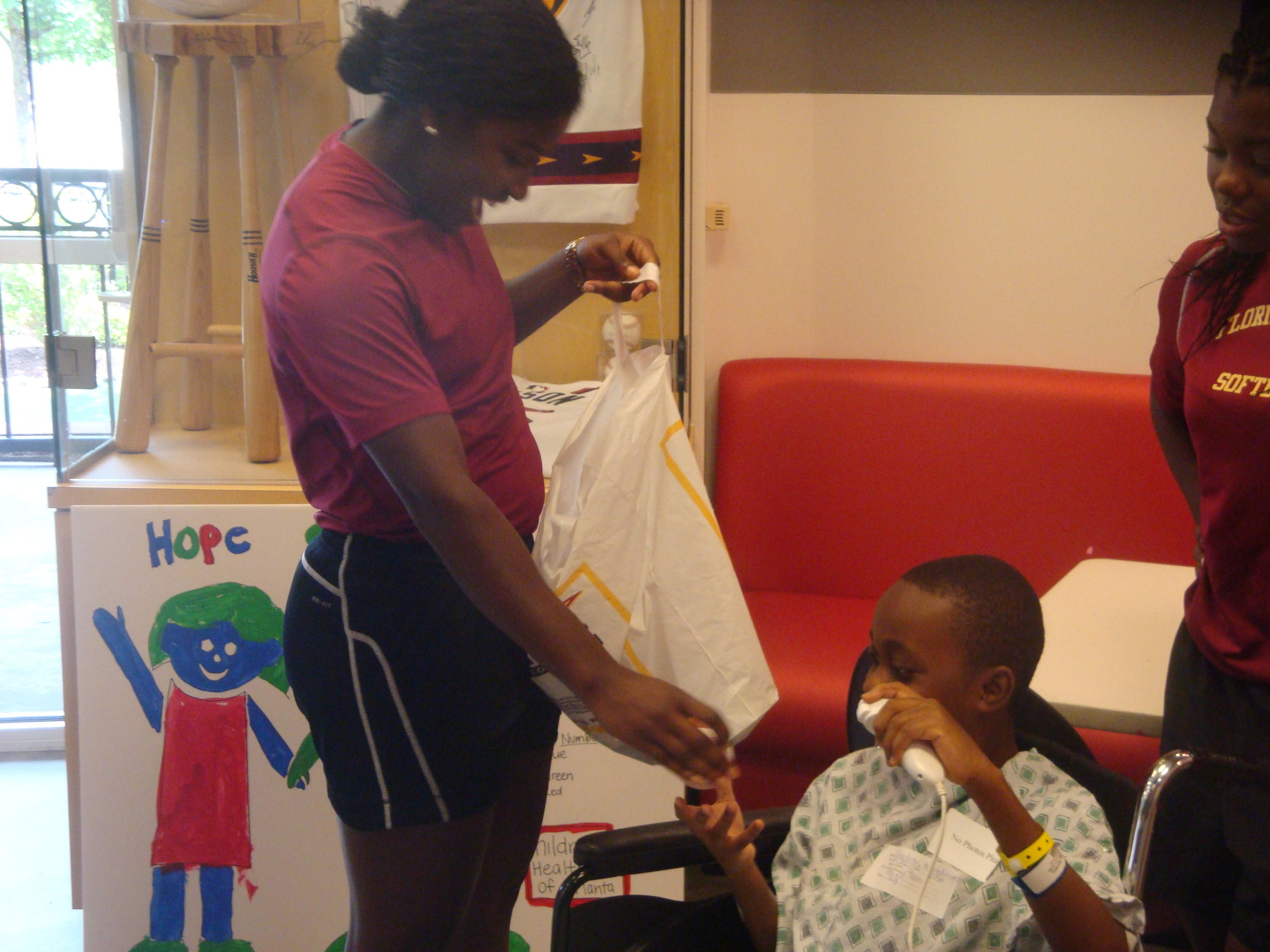Morgan Bullock gives Emanuel some gifts from the FSU softball team