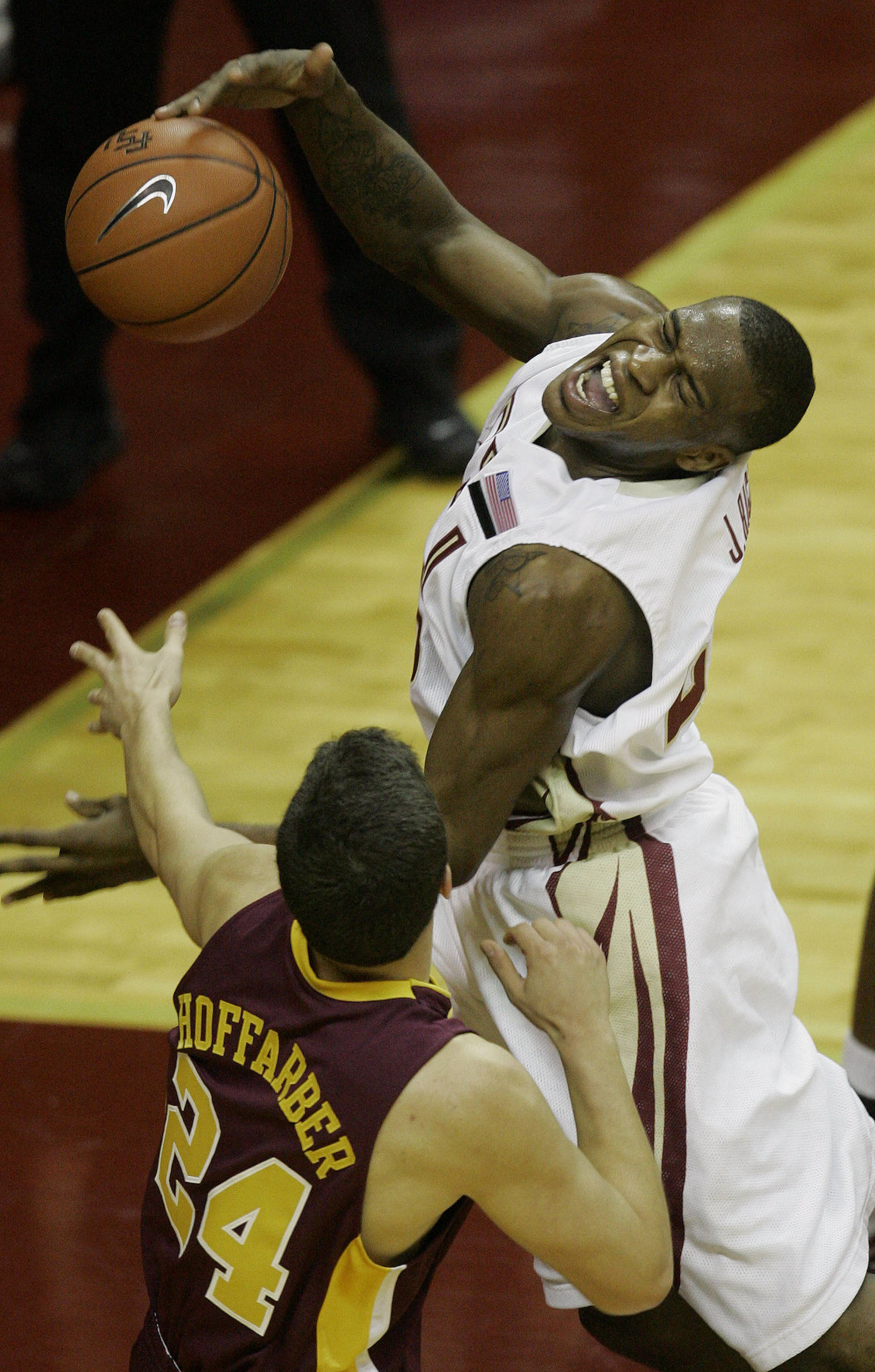 Florida State's Jason Rich is fouled by Minnesota's Blake Hoffarber during the first half.