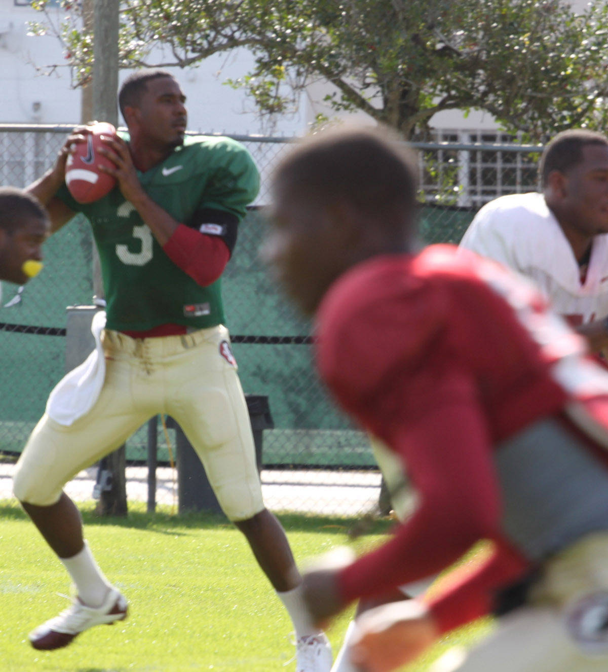 EJ Manuel drops back to pass during the first Champs Sports Bowl practice.