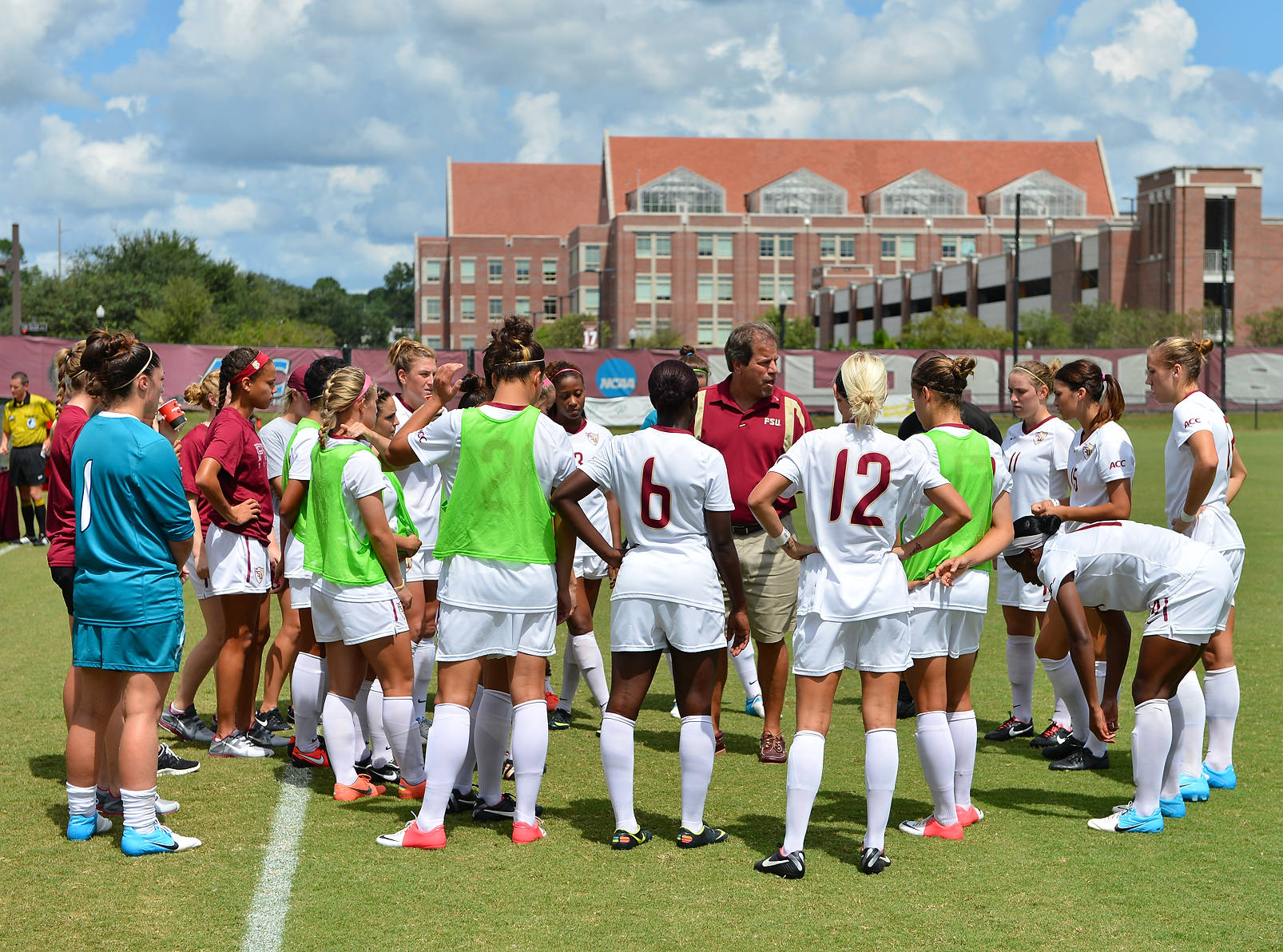 Head coach Mark Krikorian address the Seminoles before the start of Sunday's match against Wake Forest.
