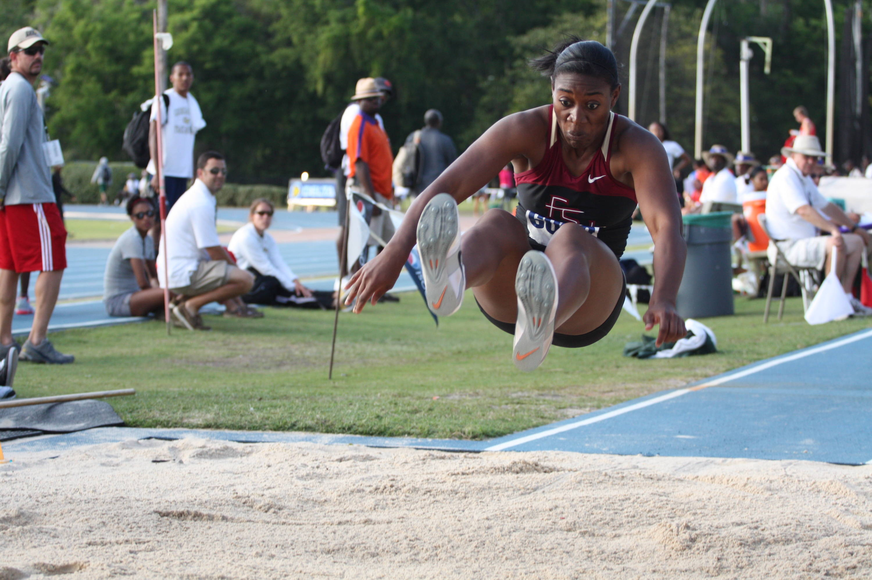 Michelle Jenije is about to touch down with her winning triple jump Saturday at the Florida Relays.
