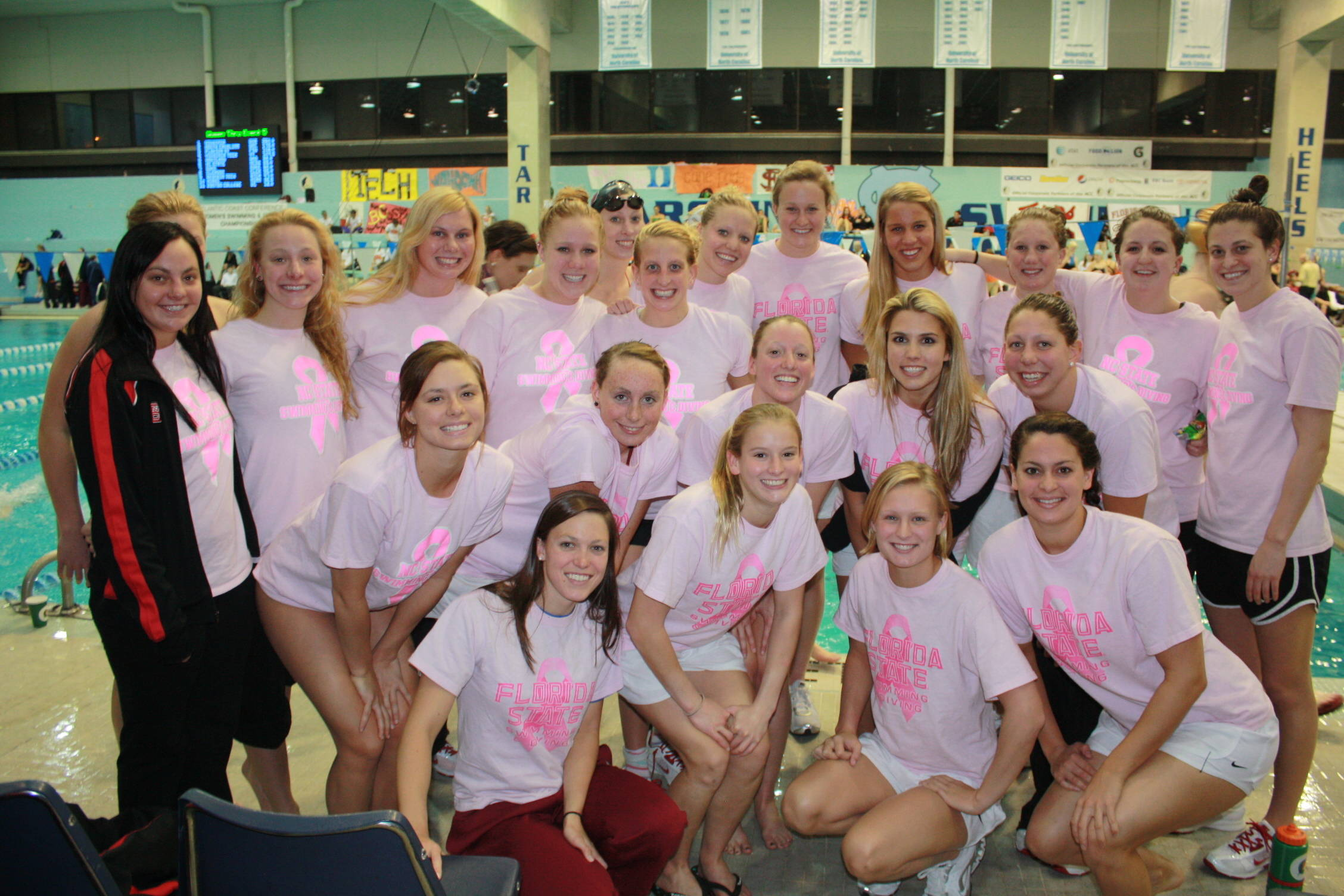 ACC Championships, the Seminoles and the Wolfpack show off their breast cancer awareness shirts.